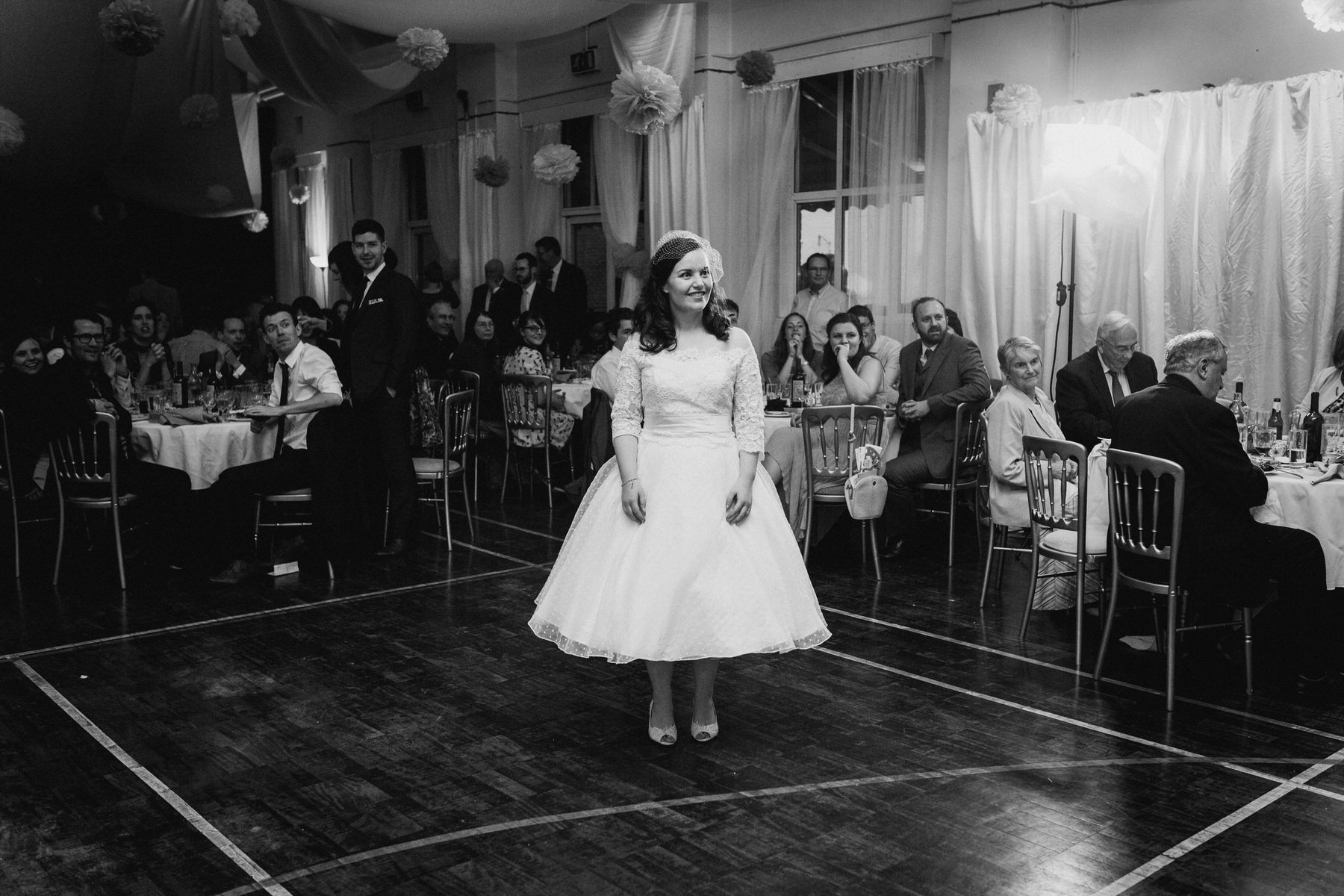 252 BW bride awaiting first dance school hall wedding London.jpg