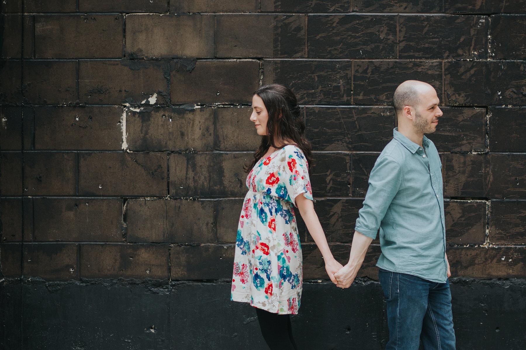 15-couple cuddling against urban background London.jpg