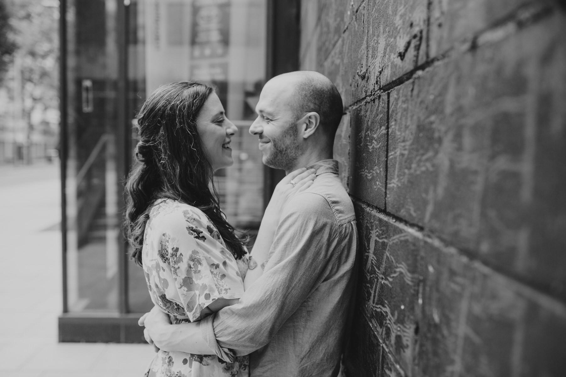 16-couple cuddling against urban background London.jpg
