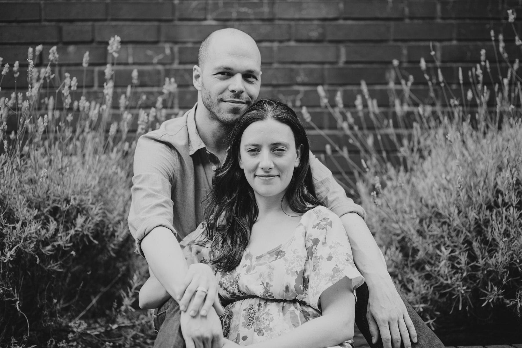 25-couple sitting in lavender bush Southbank engagement session_.jpg