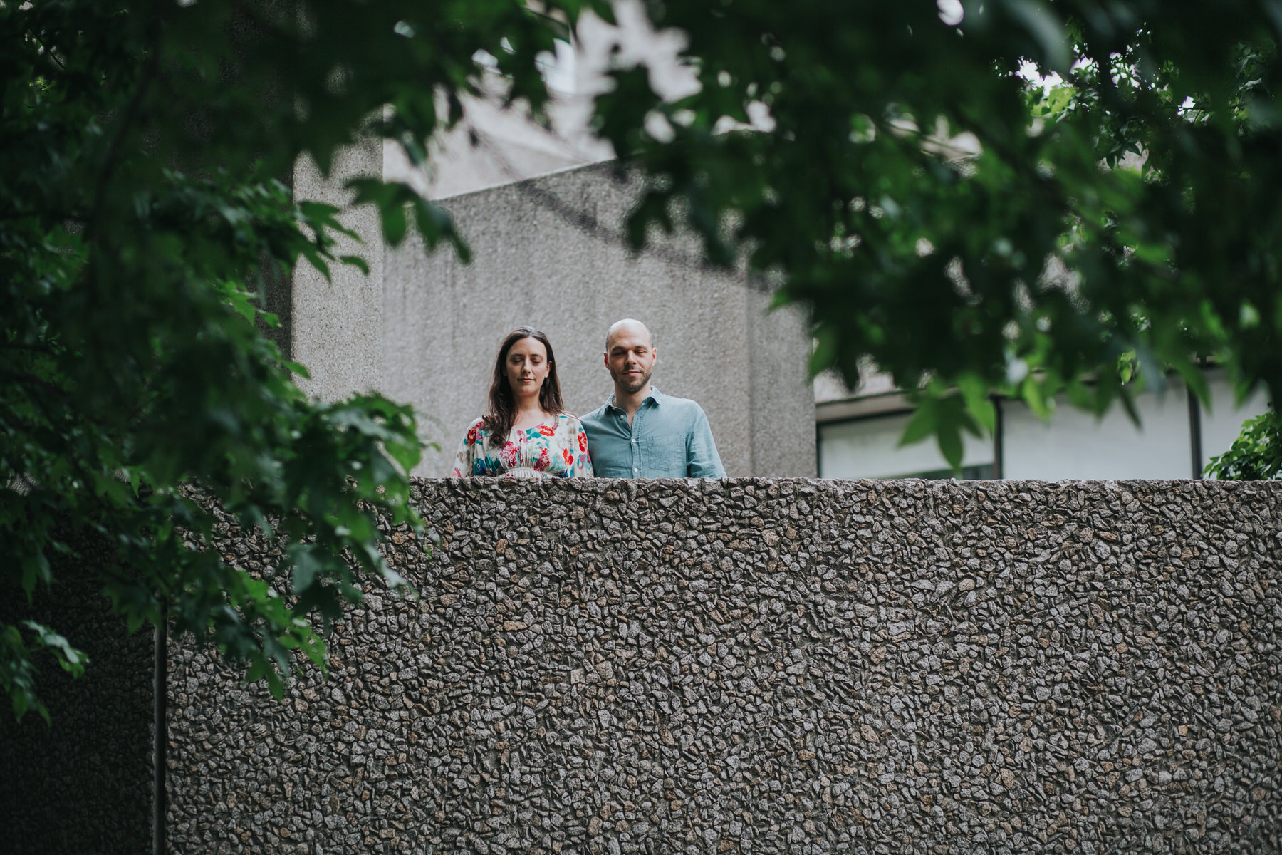 42-couple portrait shoot brutalist architecture green trees Southbank.jpg