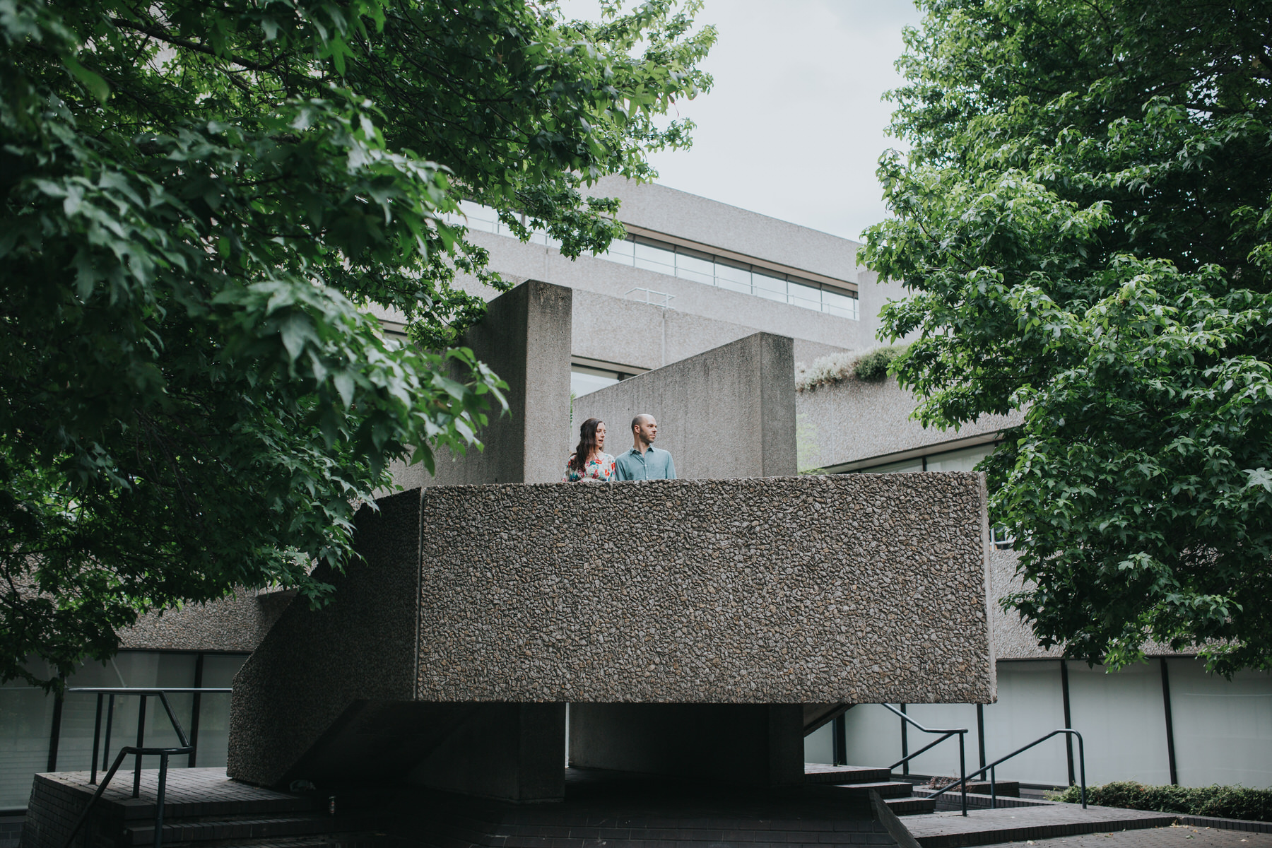 44-couple portrait shoot brutalist architecture green trees Southbank.jpg