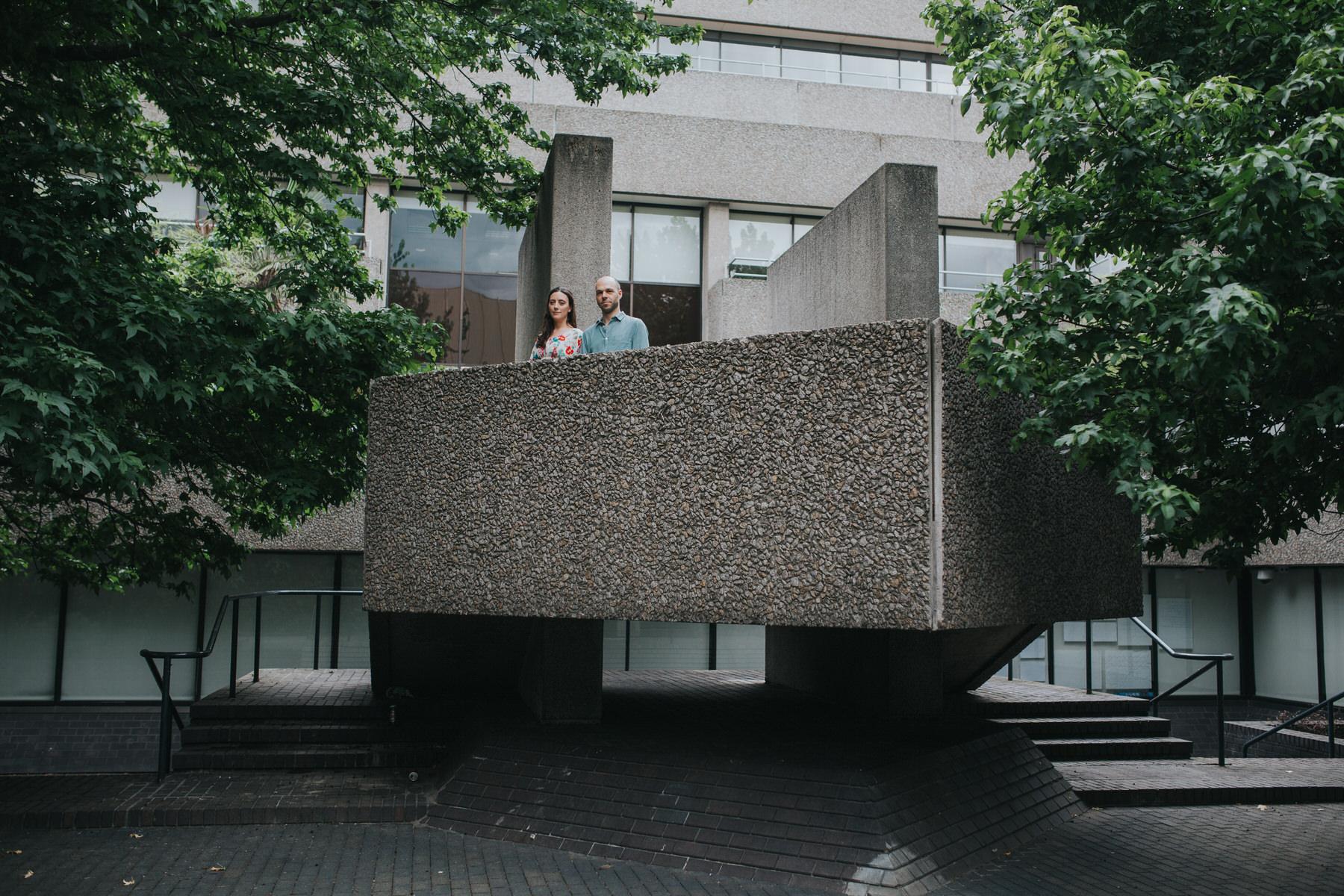 45-couple portrait shoot brutalist architecture green trees Southbank.jpg