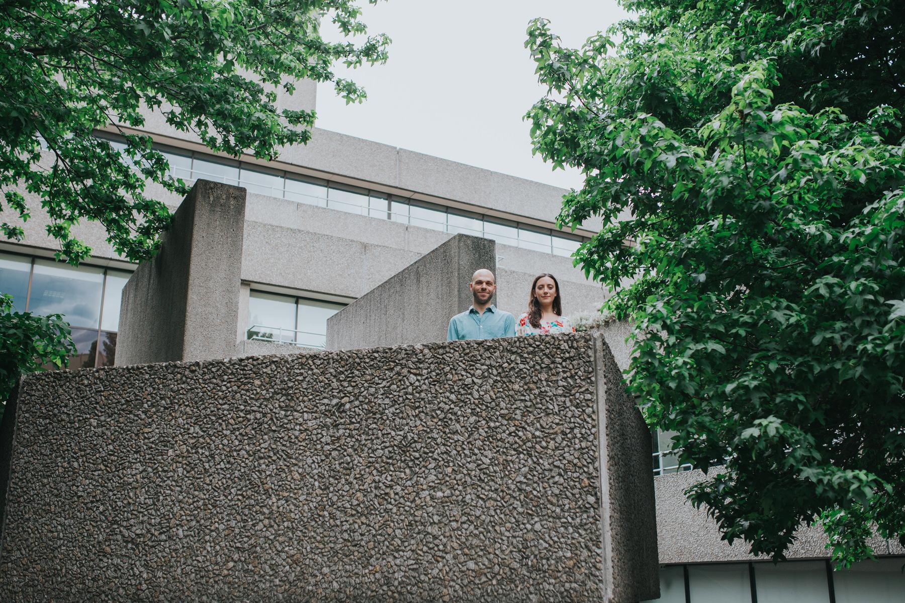 46-couple portrait shoot brutalist architecture green trees Southbank.jpg