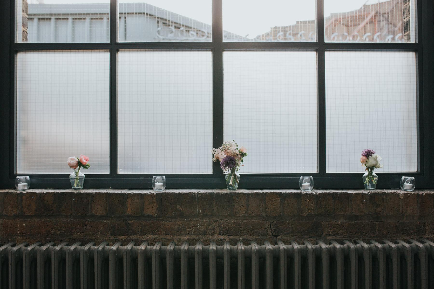 17-St Chads Place wedding small flower posies in window.jpg