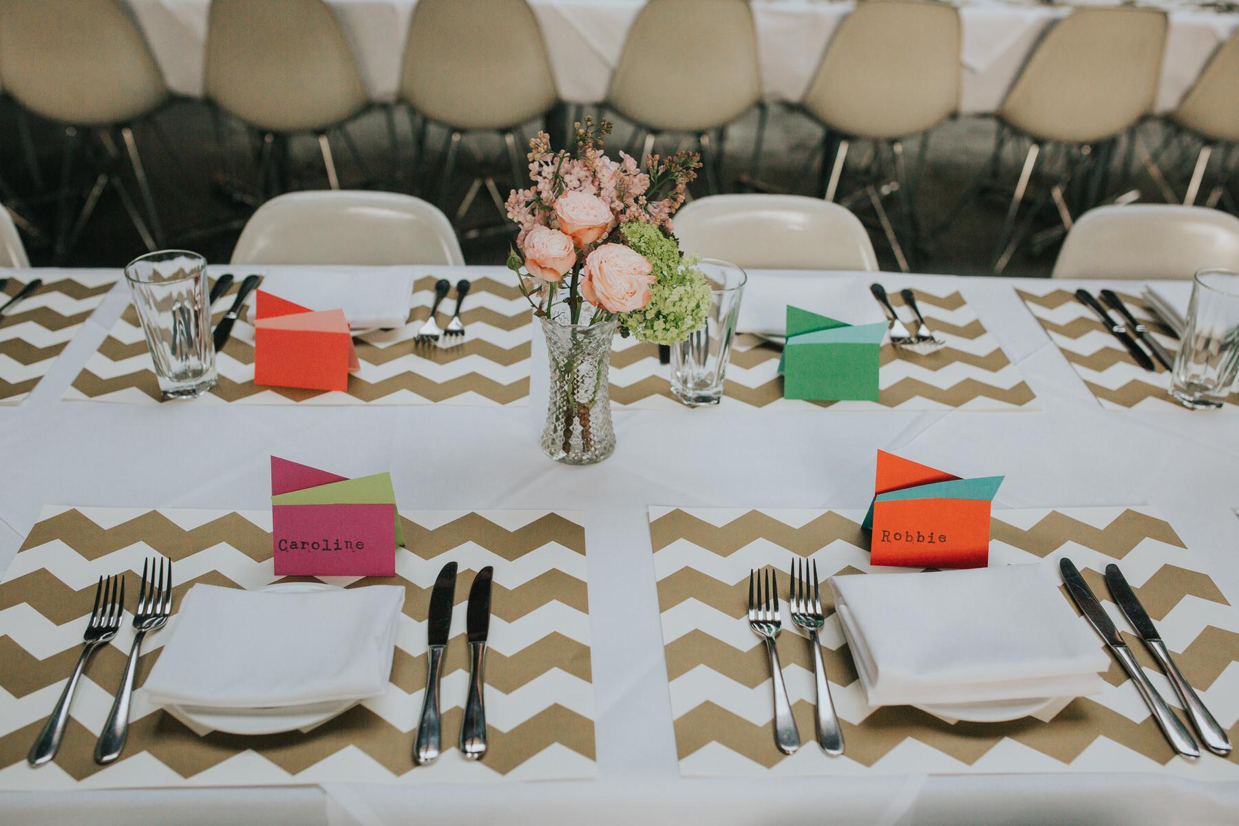21-St Chads Place wedding gold chevron table mulit colour geometric place names.jpg