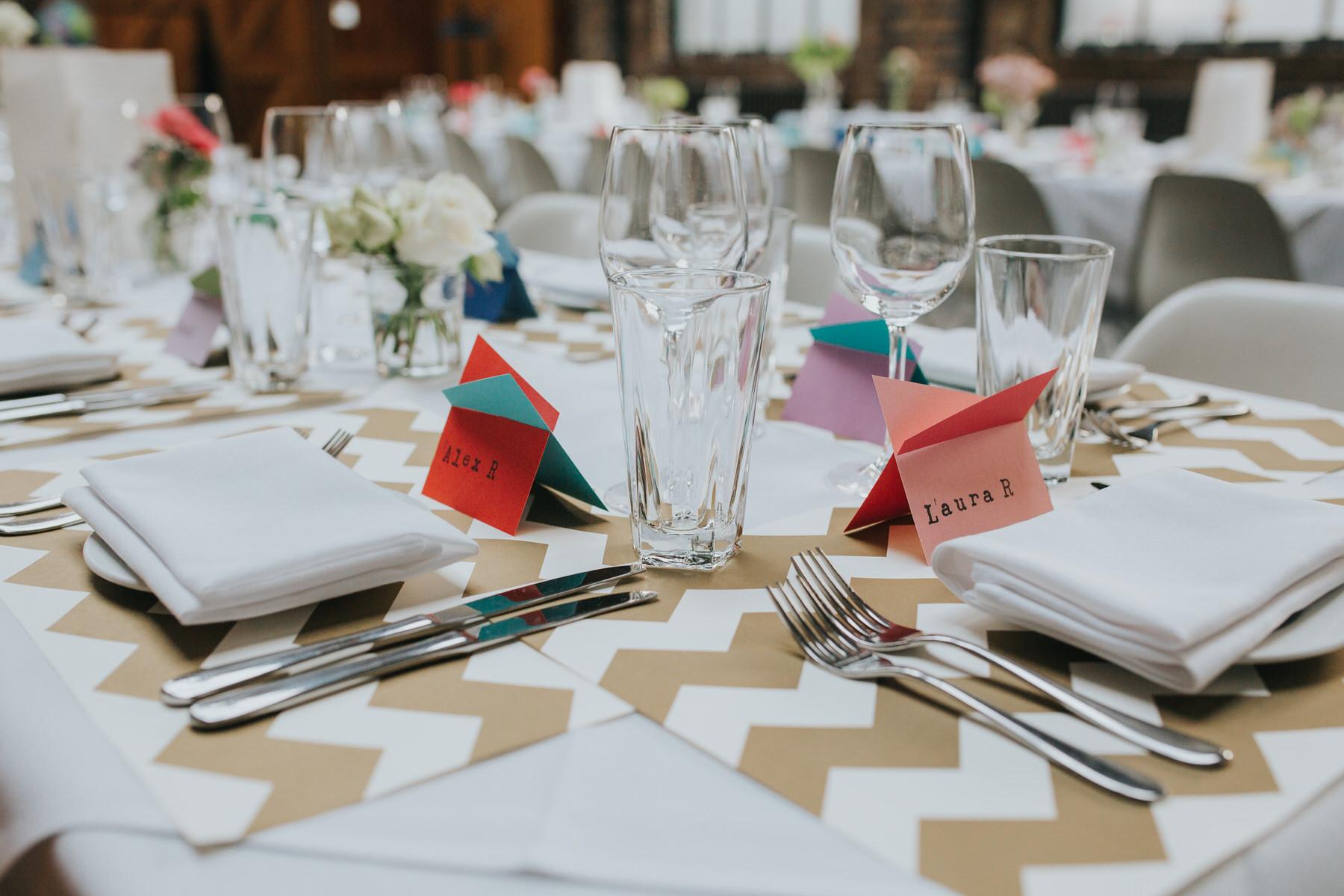 28-St Chads Place wedding gold chevron table mulit colour geometric place names.jpg
