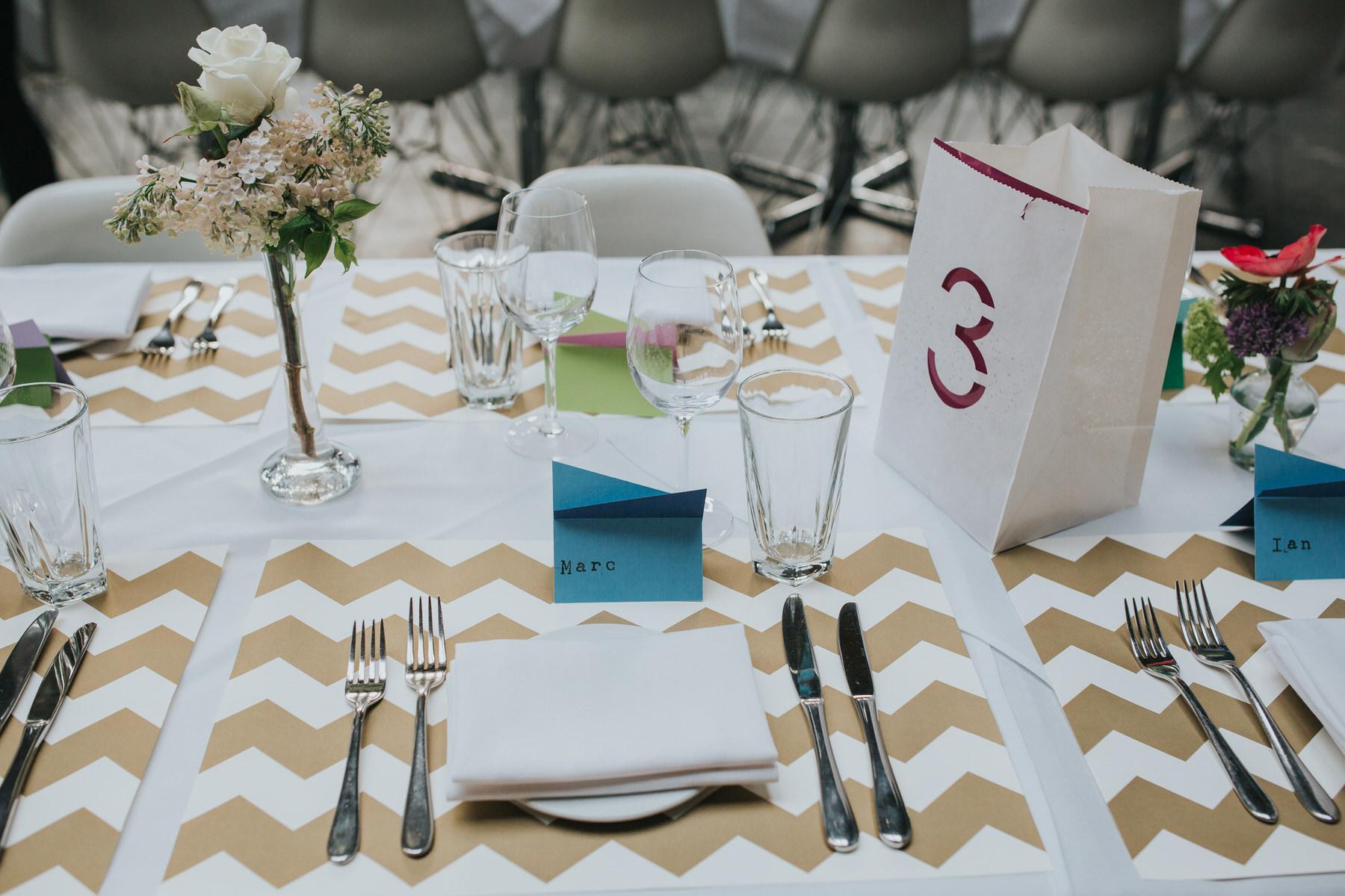 27-St Chads Place wedding gold chevron table mulit colour geometric place names.jpg