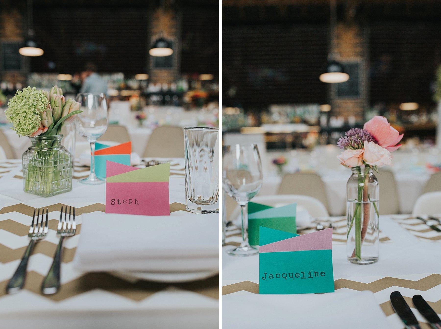 29-St Chads Place wedding gold chevron table mulit colour geometric place names.jpg