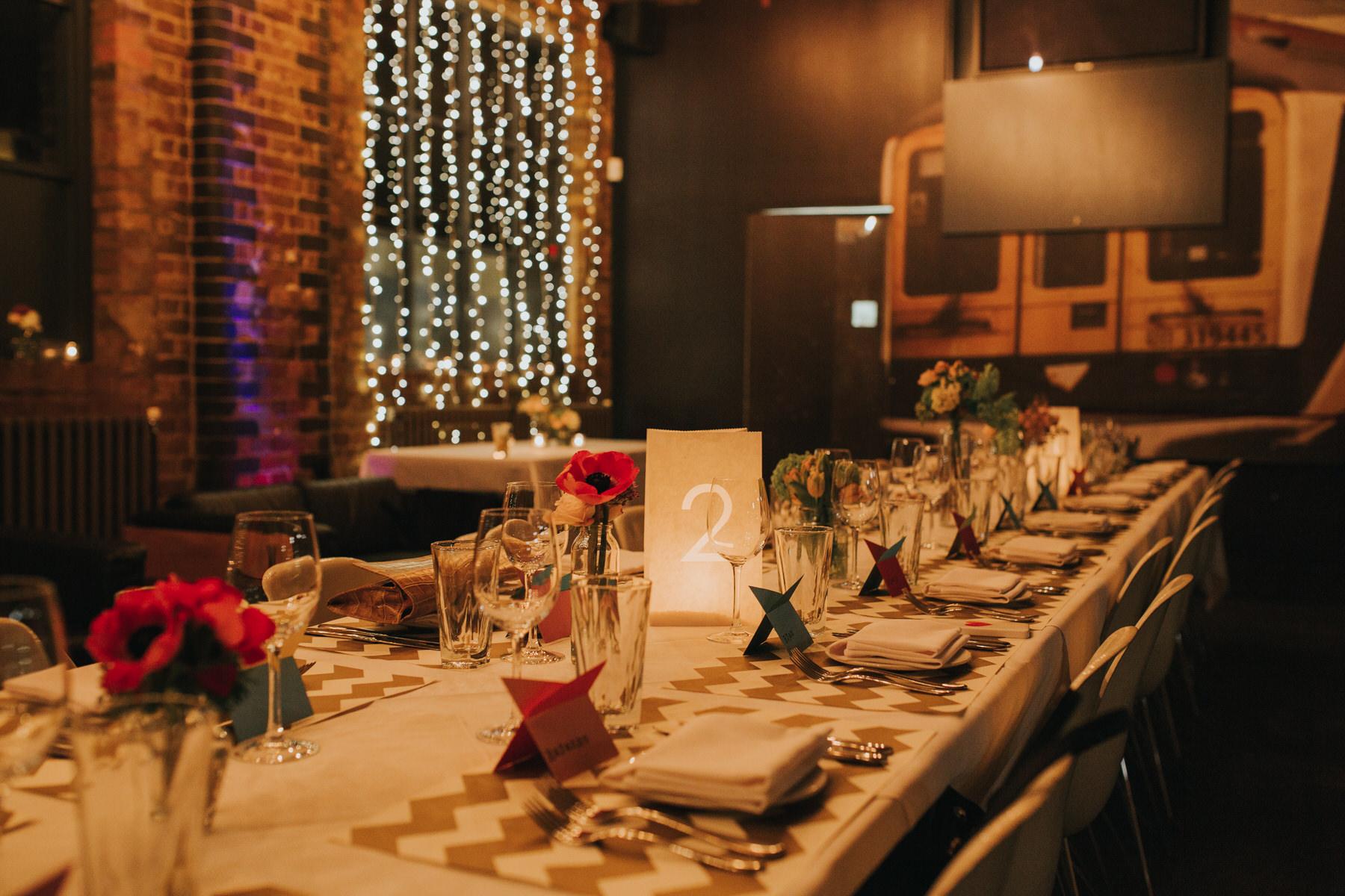 142-St Chads Place wedding urban warehouse fairylights table.jpg