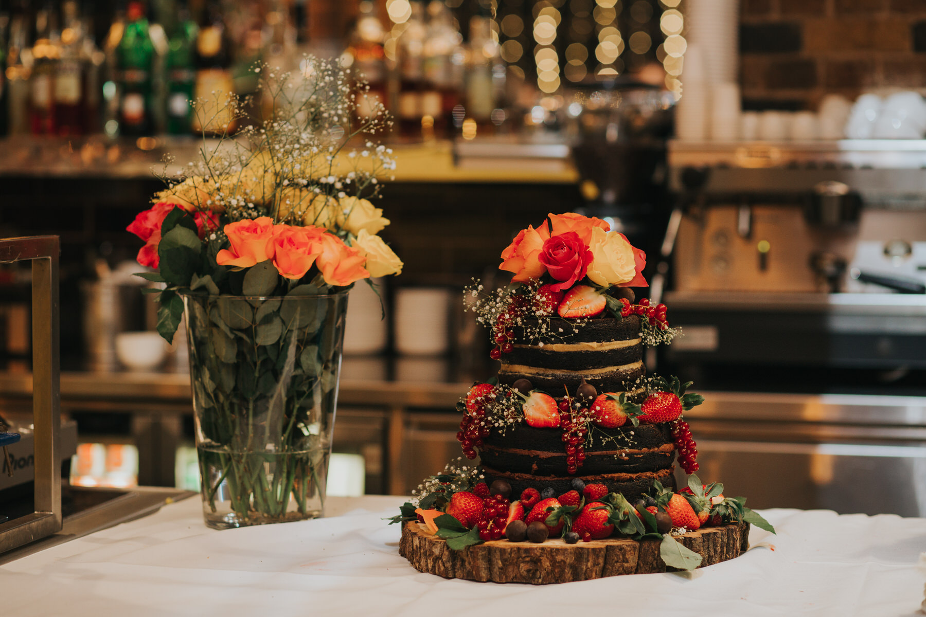 146-St Chads Place chocolate wedding cake decorated fresh roses strawberries babies breath.jpg