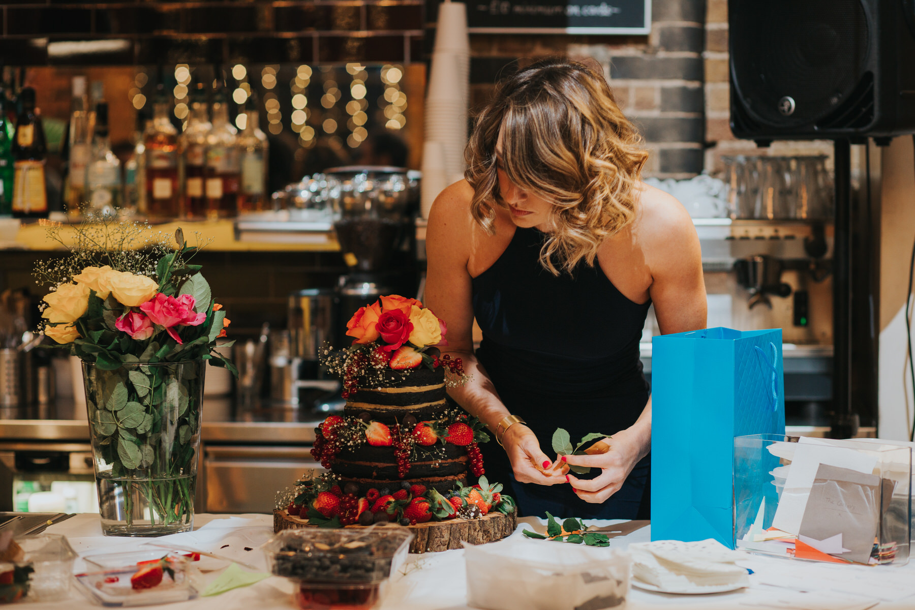 145-St Chads Place wedding chocolate cake decorated by guest fresh roses strawberries.jpg