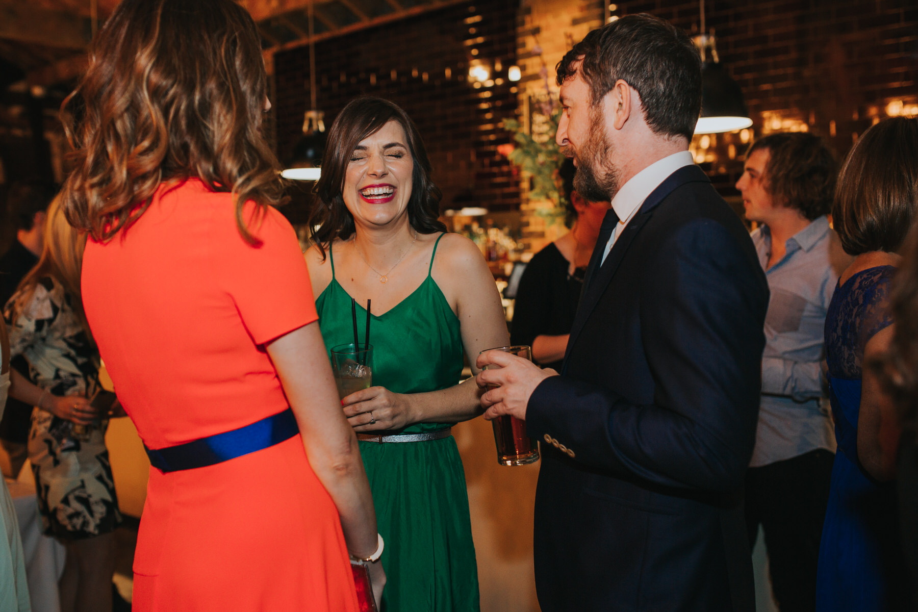 160-St Chads Place guests laughing reportage wedding.jpg