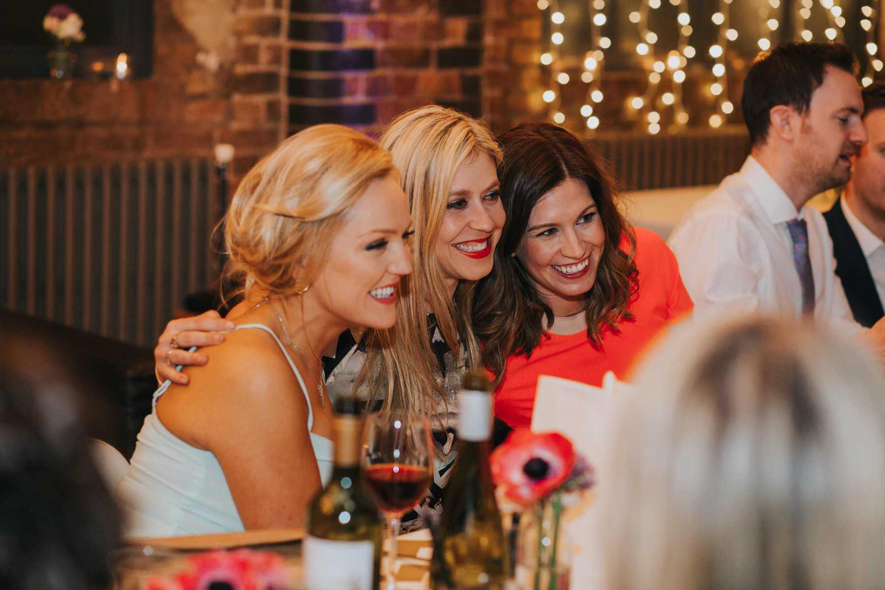 170-St Chads Place bride posing with friends.jpg