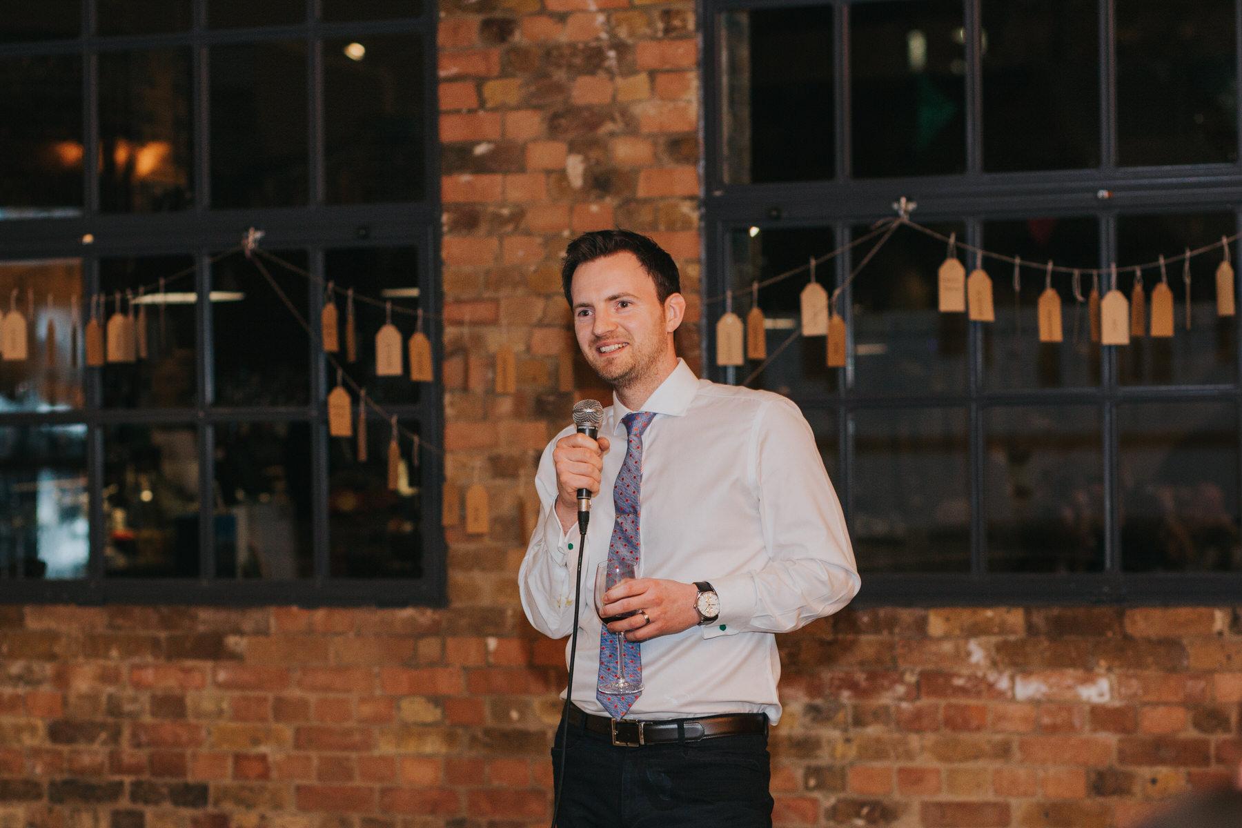 186-urban London warehouse St Chads Place groom speech.jpg
