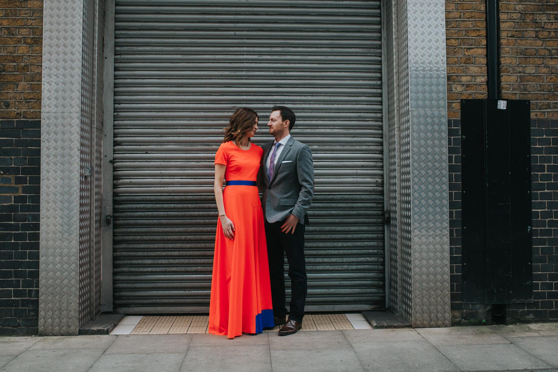 64-St Chads Place urban metalic background bride wearing neon dress couple portrait wedding.jpg