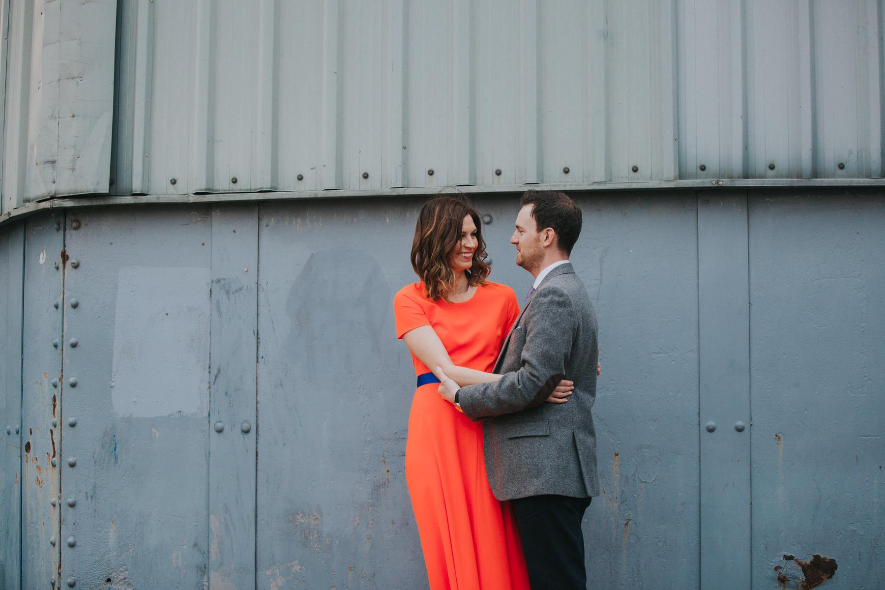 50-St Chads Place industrial wedding vibe bride wearing orange dress.jpg