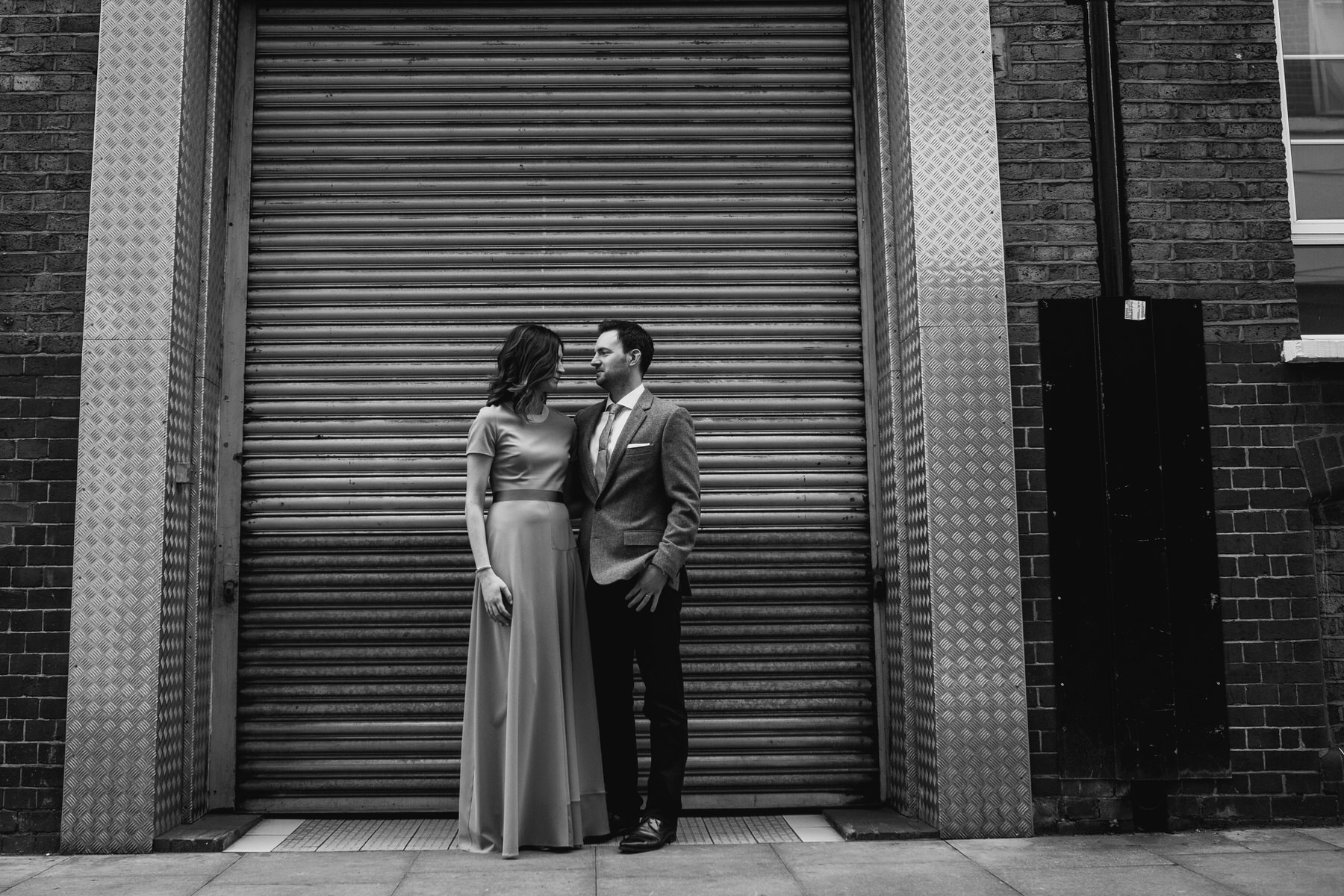 65-St Chads Place BW couple portrait against metal door.jpg