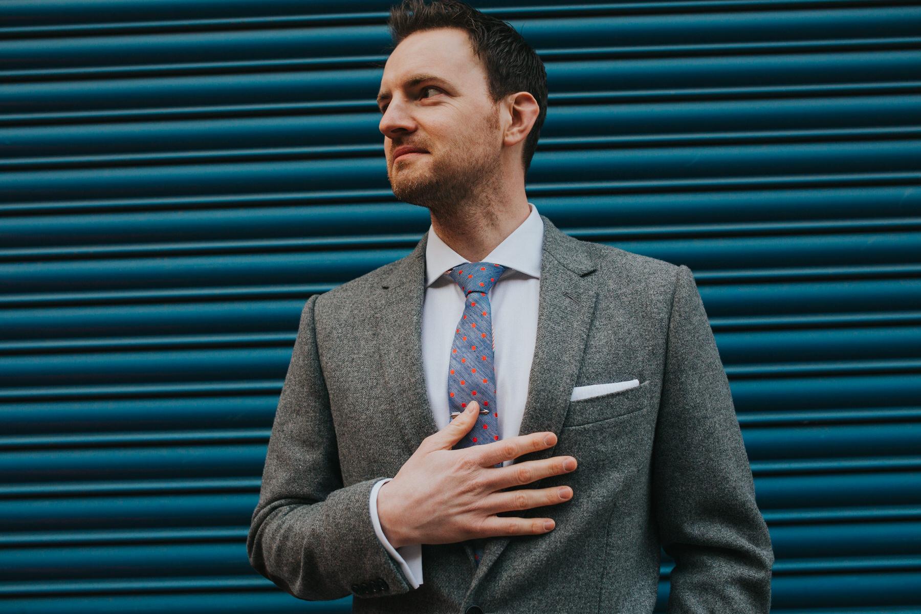 76-groom wedding attire blue metal door.jpg
