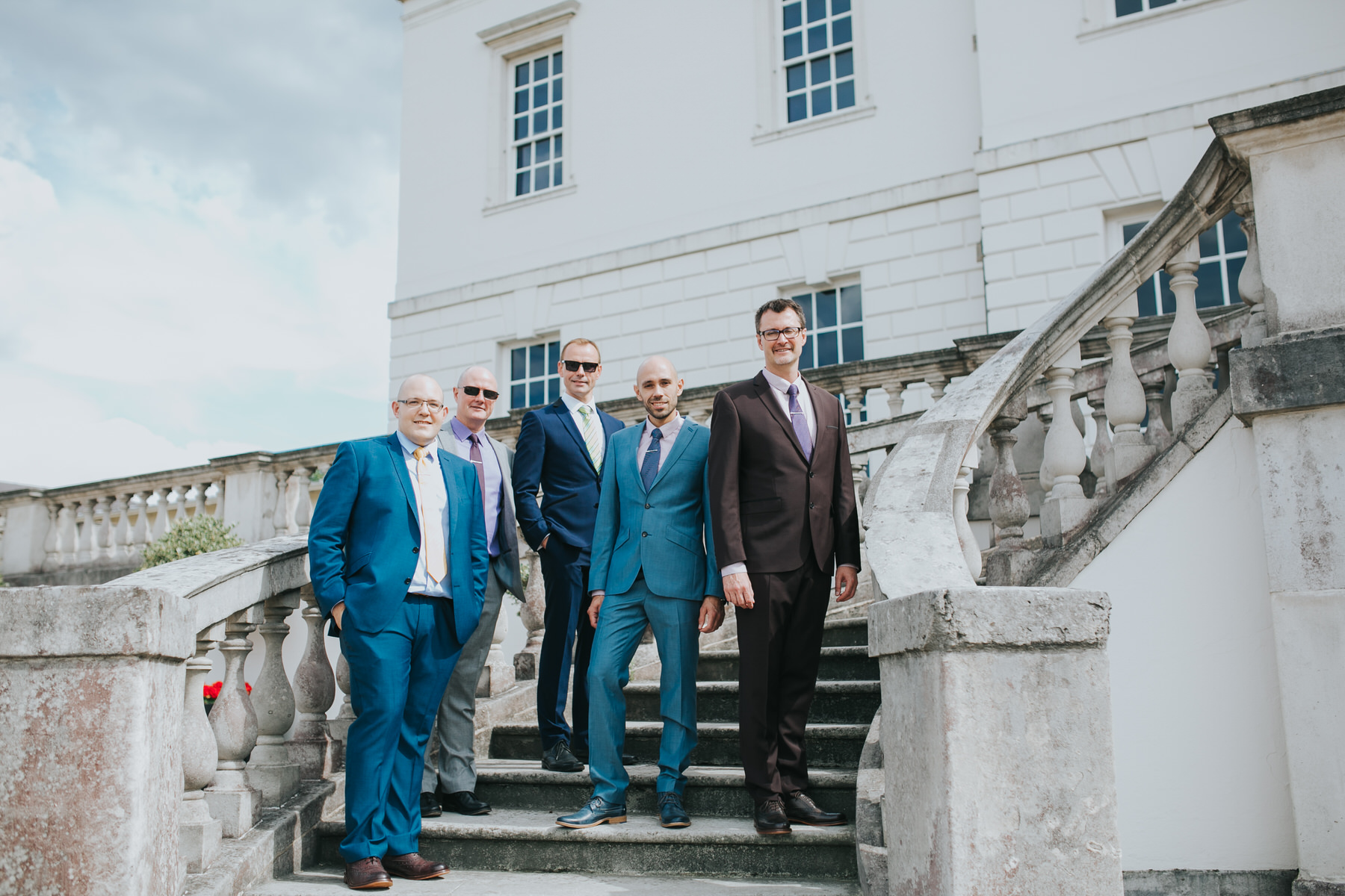 50 grooms with bestman brothers group photo Greenwich London.jpg