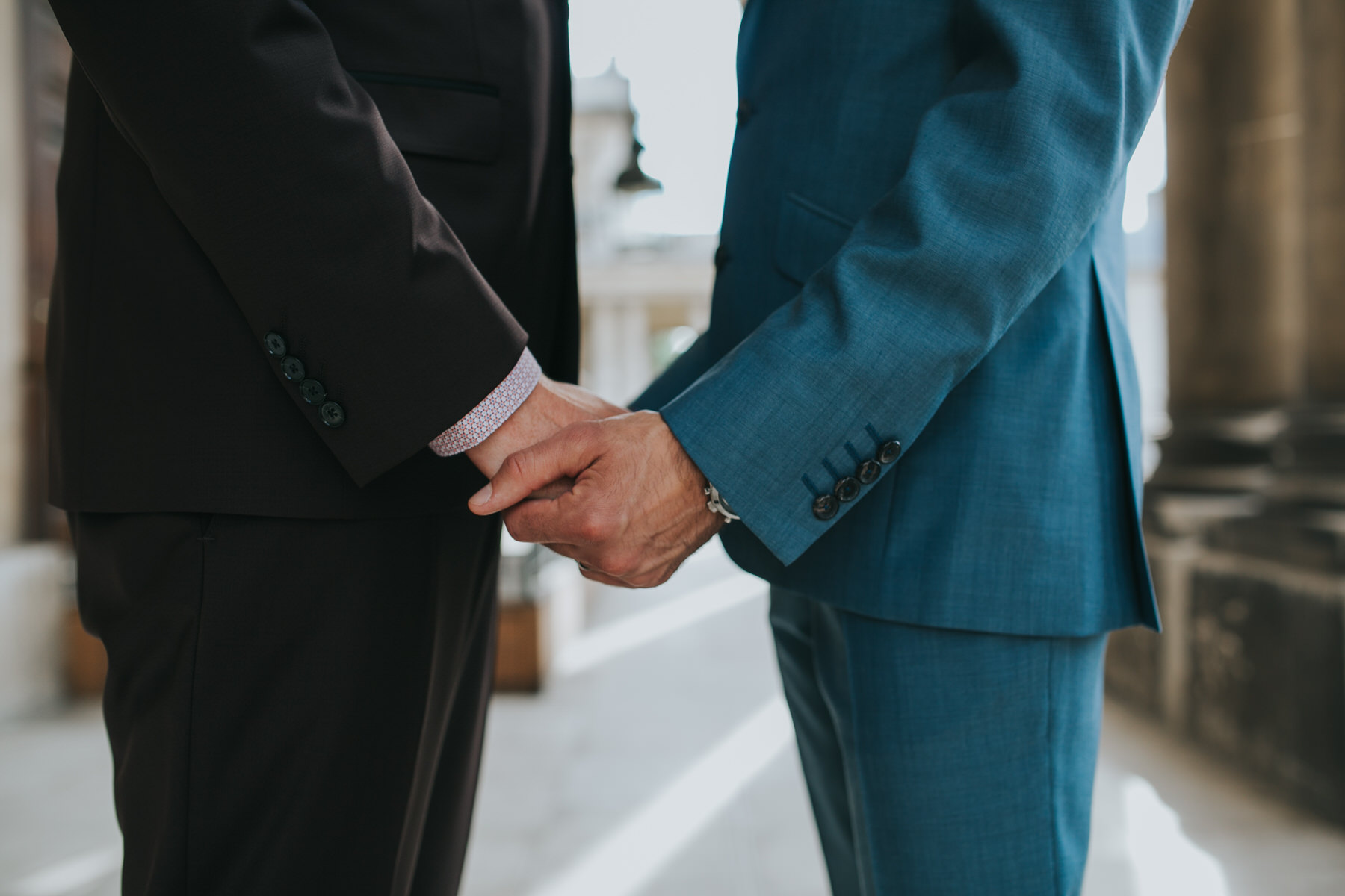 121 two grooms holding hands detal shot.jpg
