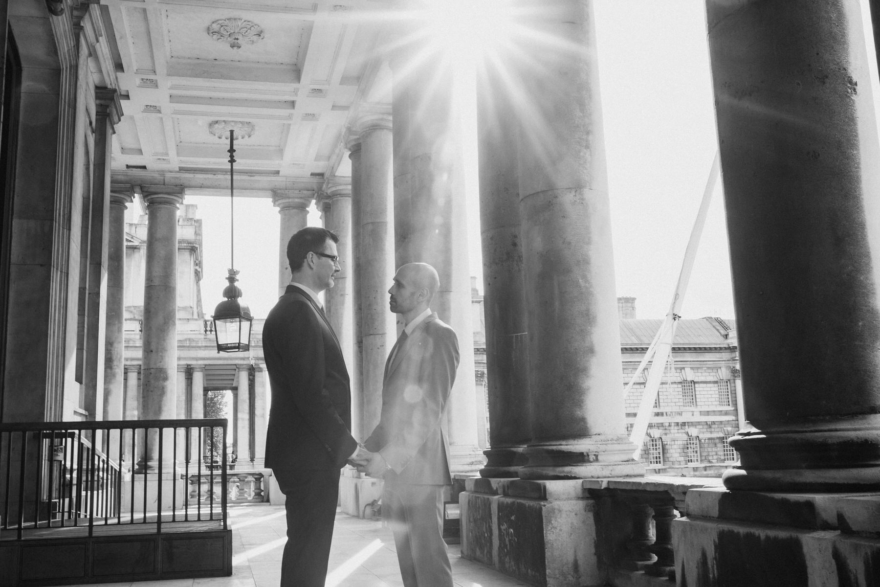 124 BW light flare Greenwich wedding couple portrait two grooms.jpg