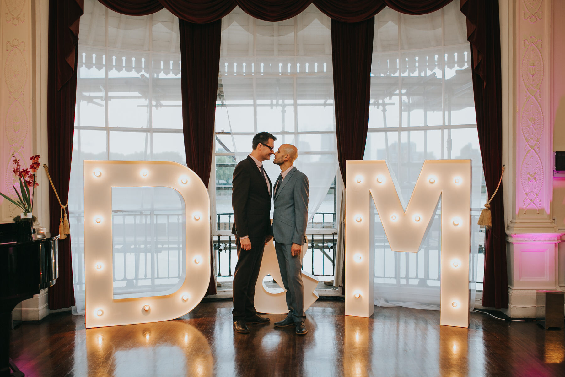 189 two grooms light up letters wedding portraits London.jpg