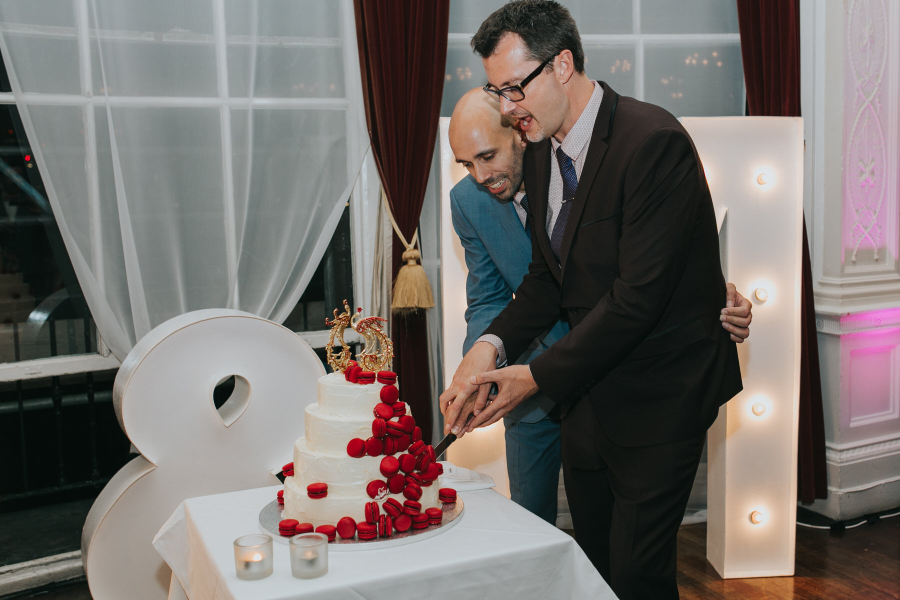 228 two grooms cutting wedding cake.jpg