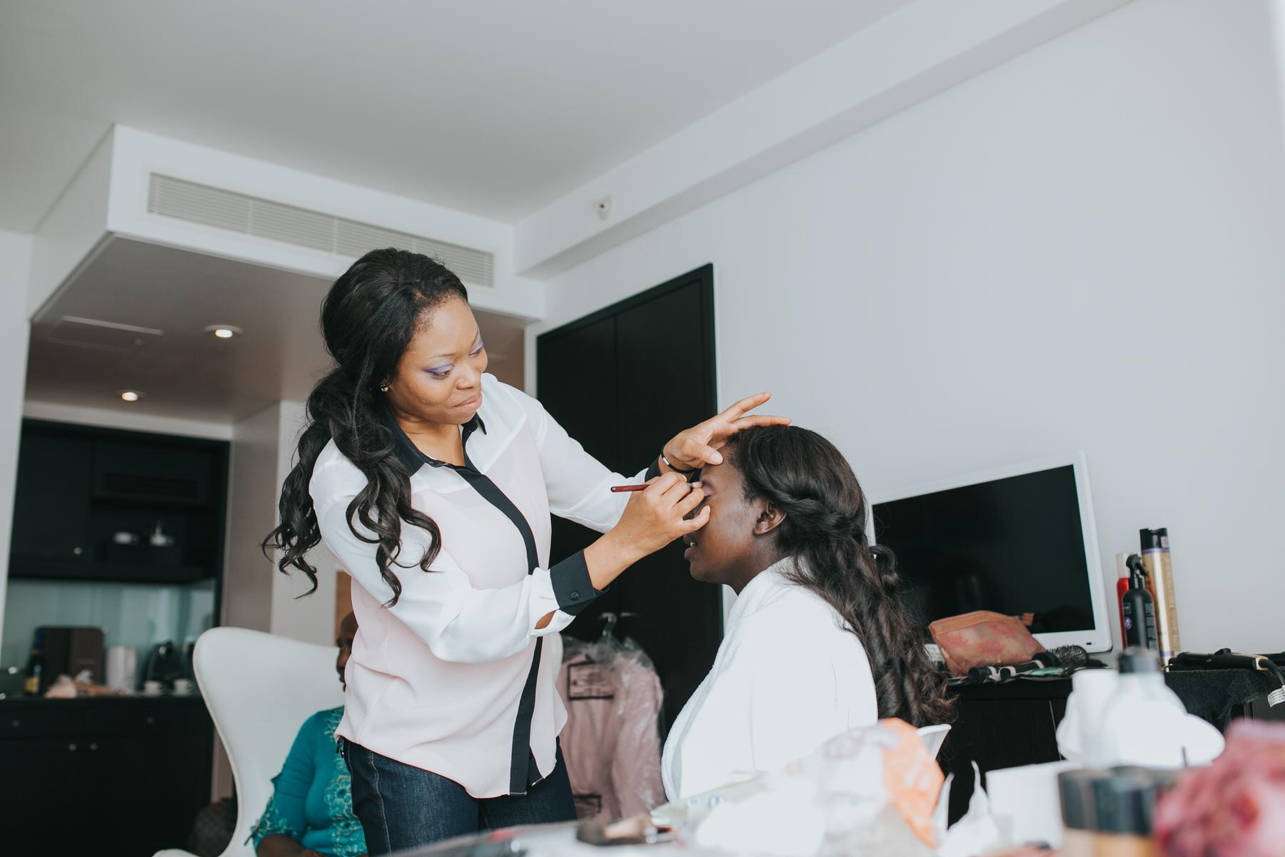 20-bridal preparations bride having wedding makeup applied.jpg