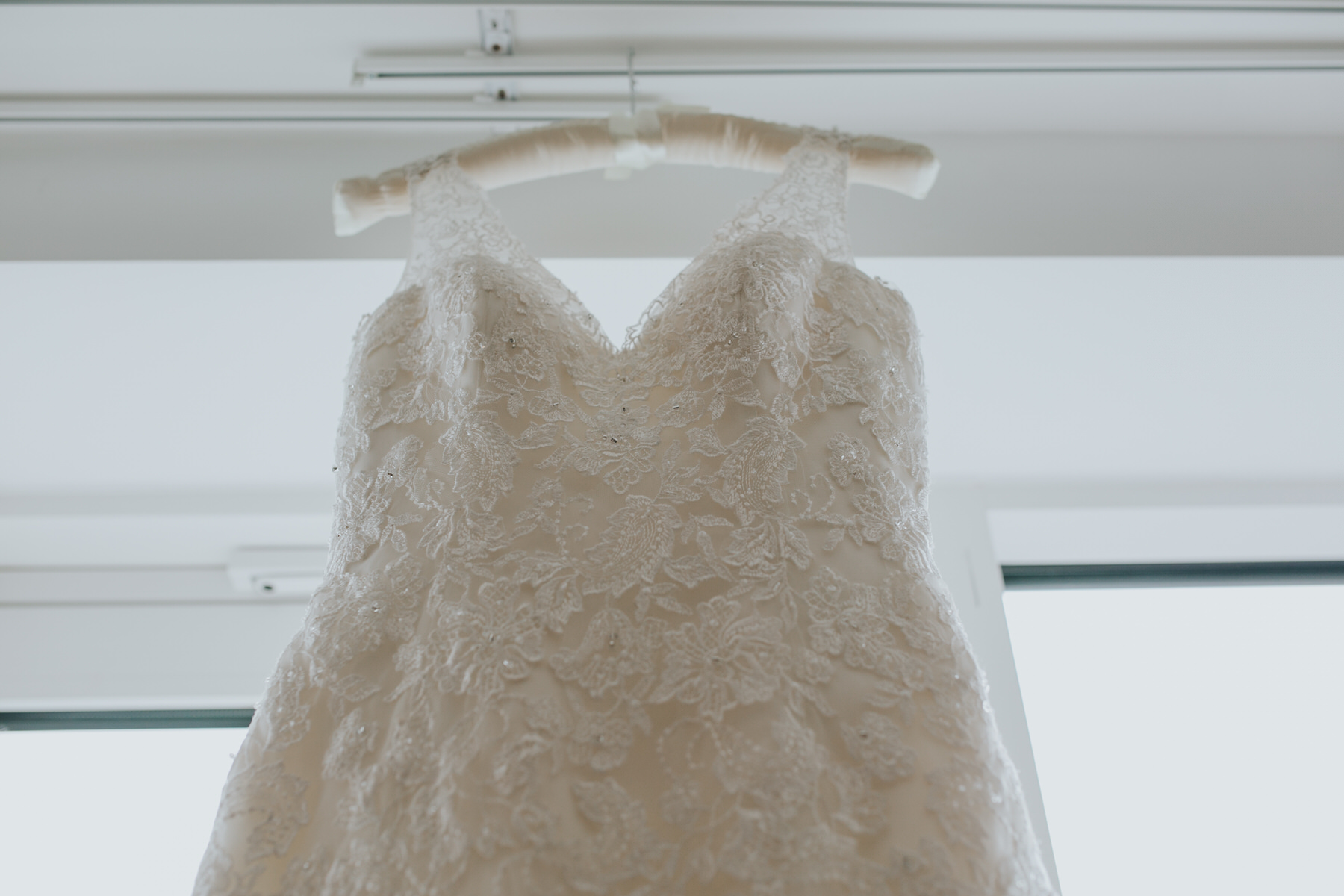 27-Maggie Sottero lace wedding dress hanging from nice hanger.jpg
