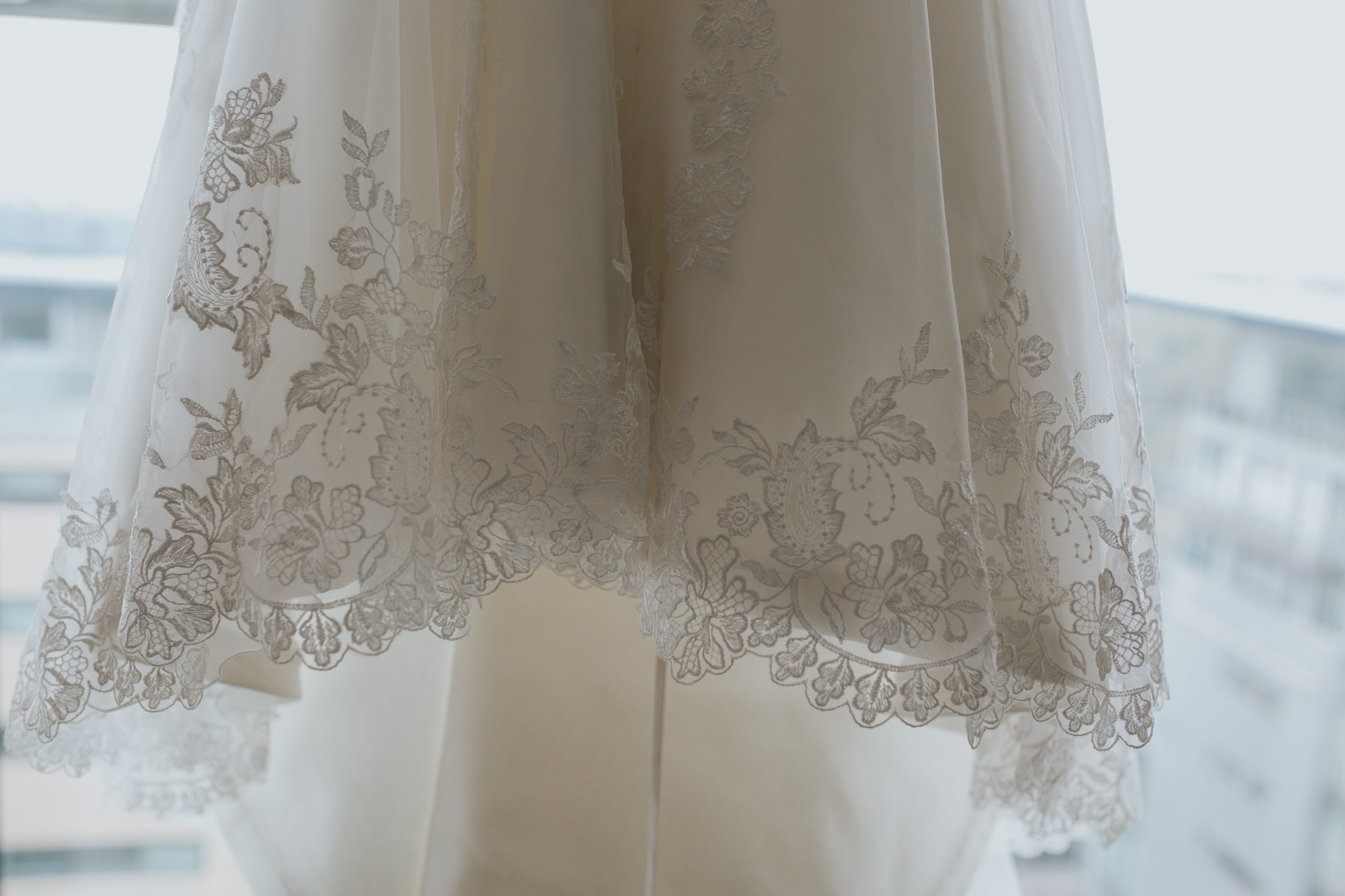 28-Maggie Sottero lace wedding dress hem detail.jpg