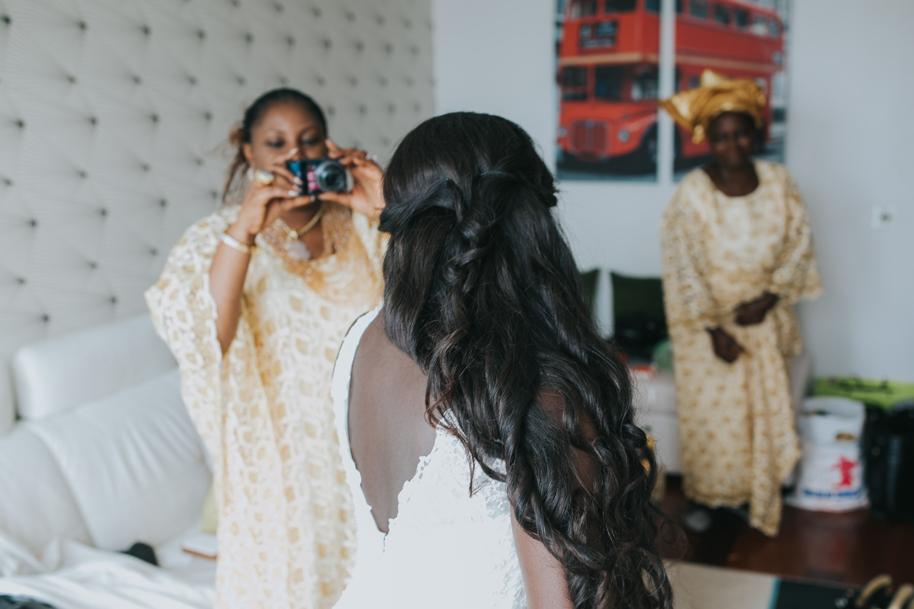 44-bridal party in traditional wedding dress taking photos of bride.jpg
