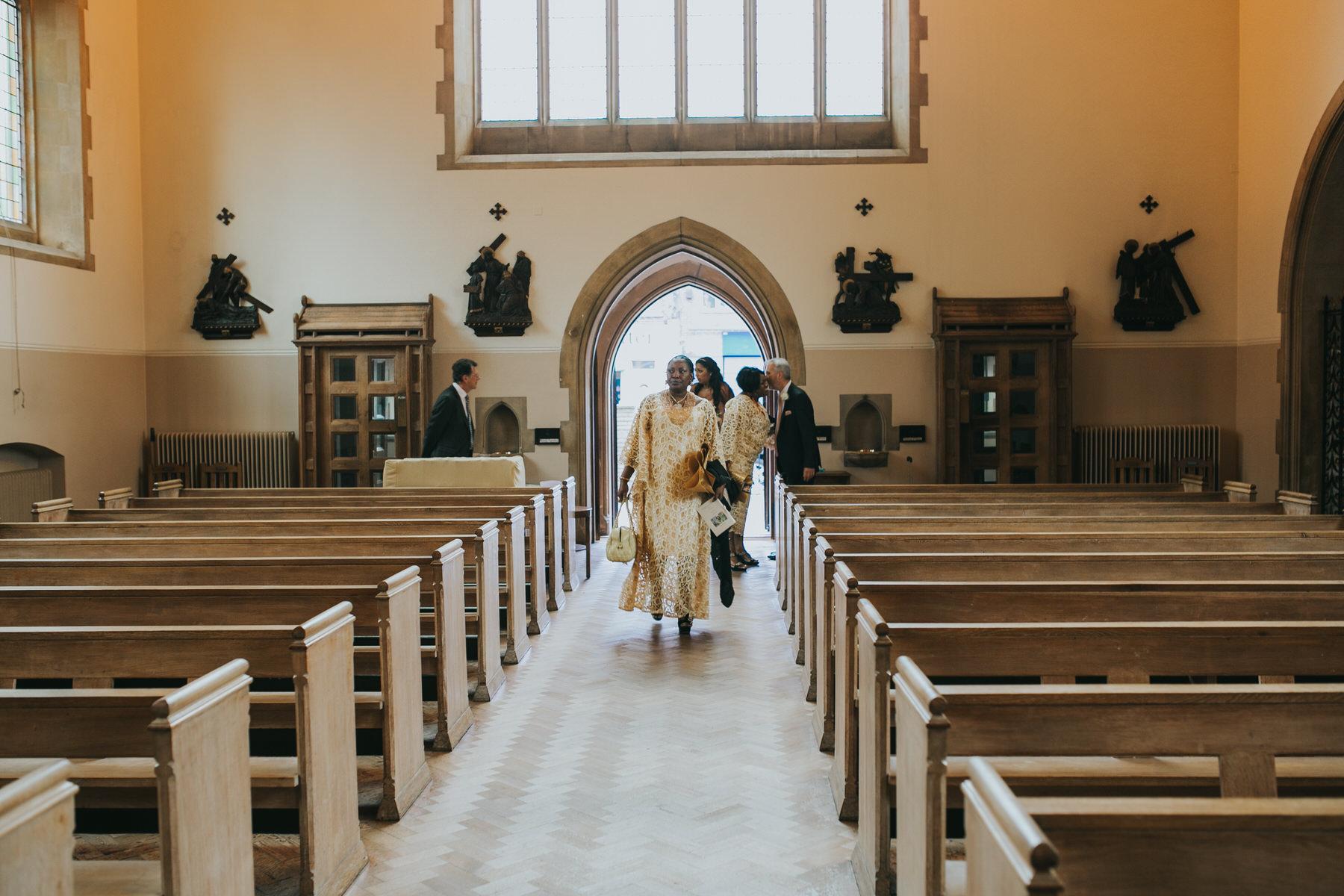 53- St Thomas More Church Dulwich wedding guests arrive.jpg
