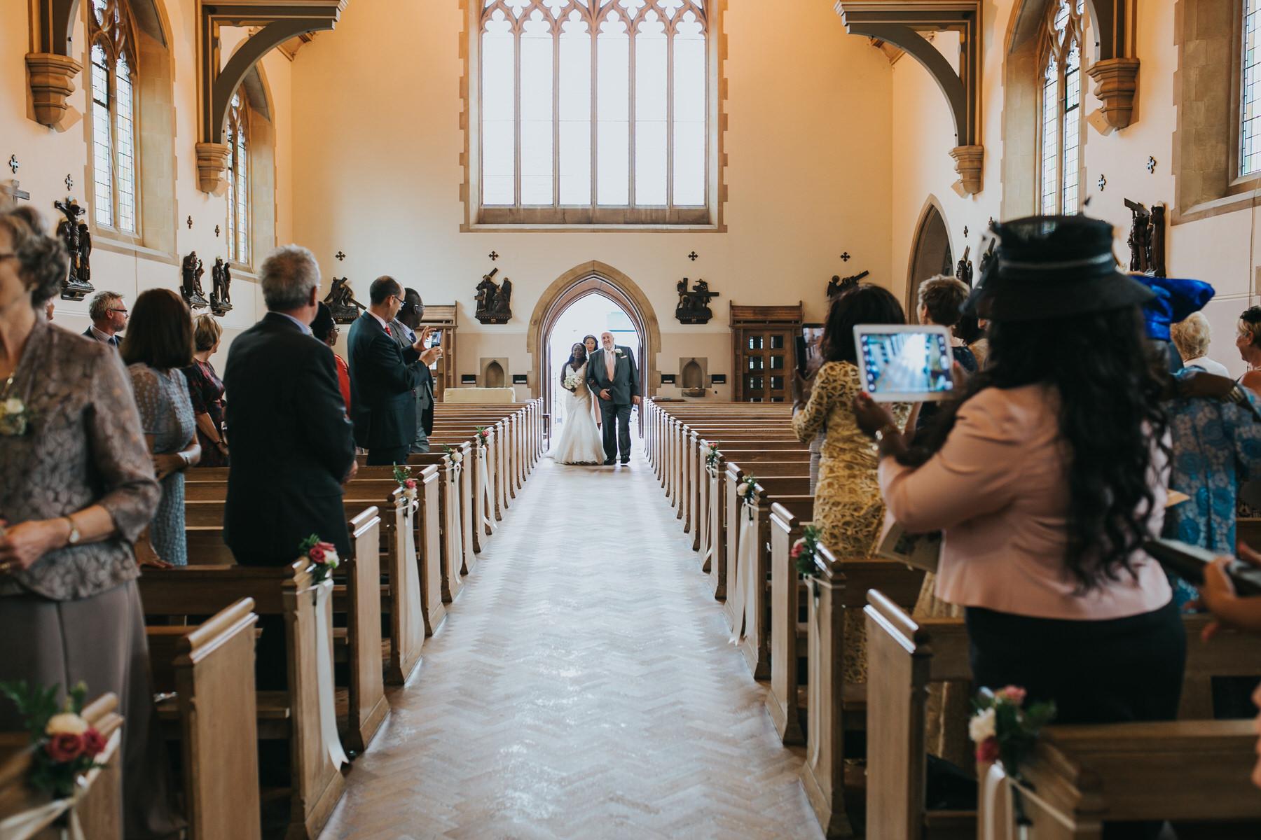 61- bride walking down aisle St Thomas More Church Dulwich wedding.jpg