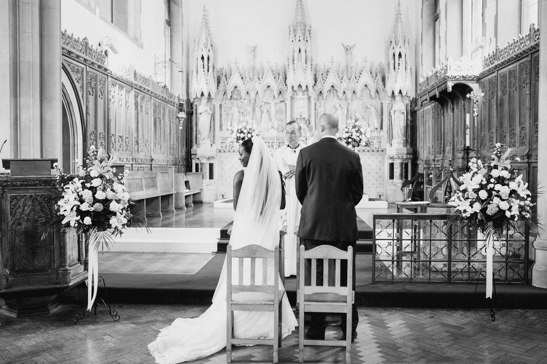 76 bride looks back during ceremony.jpg