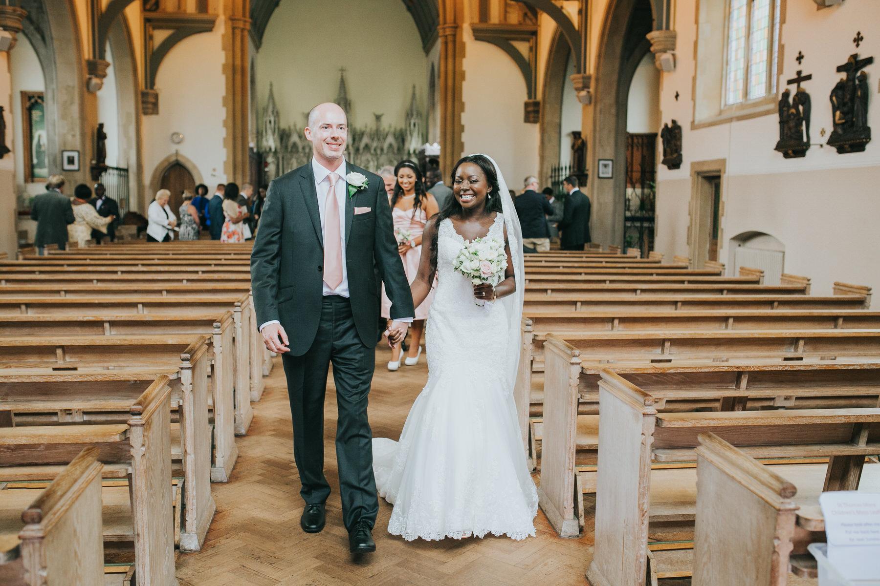 89 bride and groom leaving church hand in hand.jpg