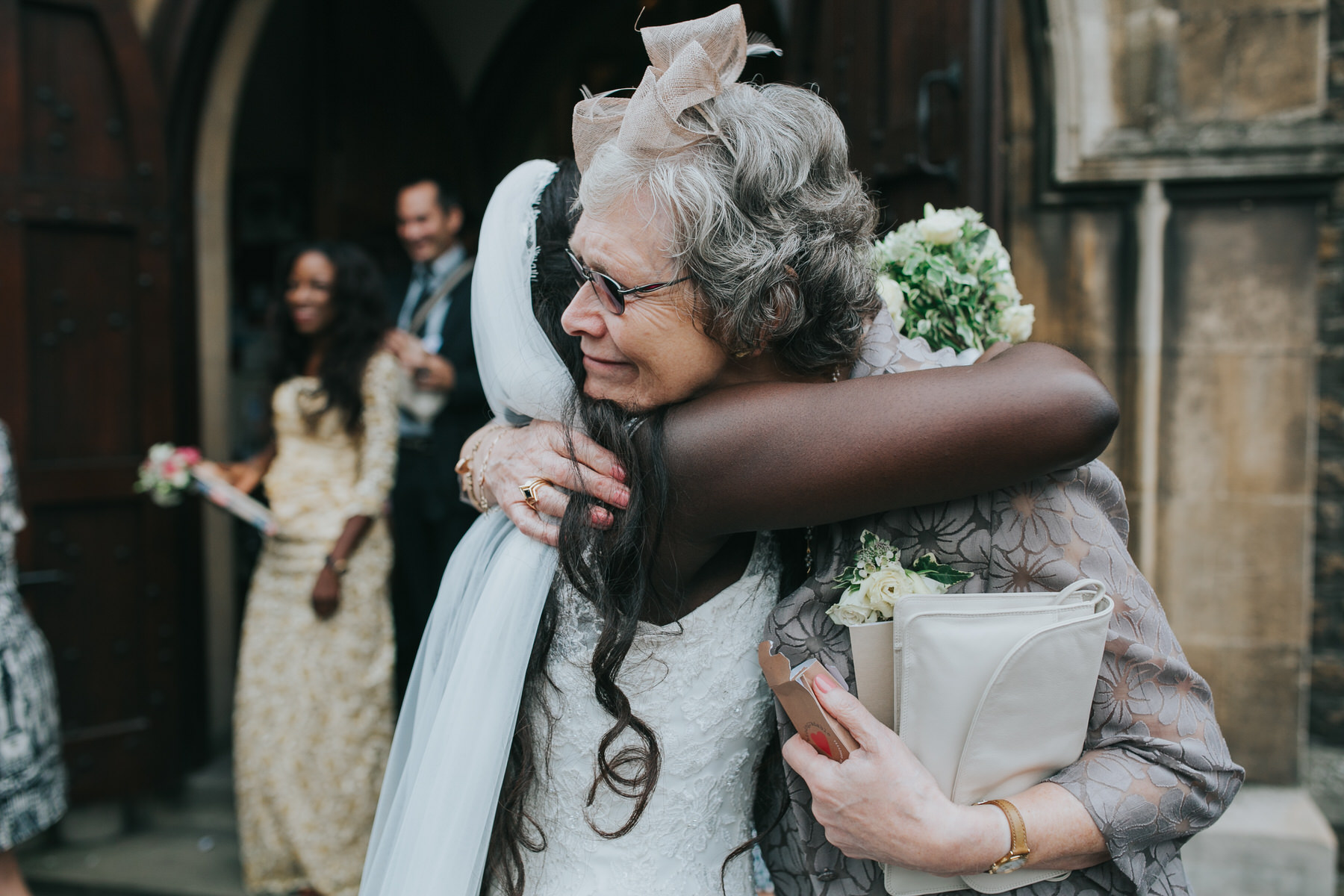 97 bride hugging mother in law documentary wedding image.jpg