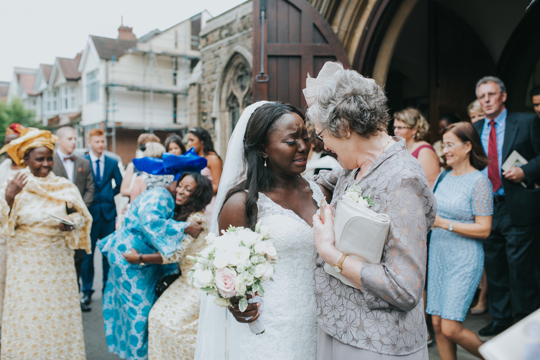 99 bride and mother of groom emotional embrace London wedding.jpg