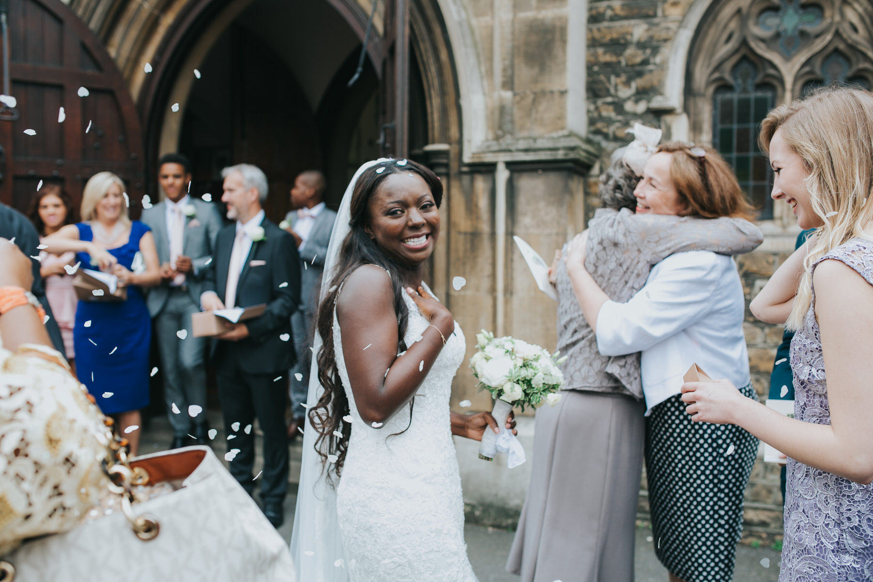 102 confetti floating over bride reaction photo.jpg