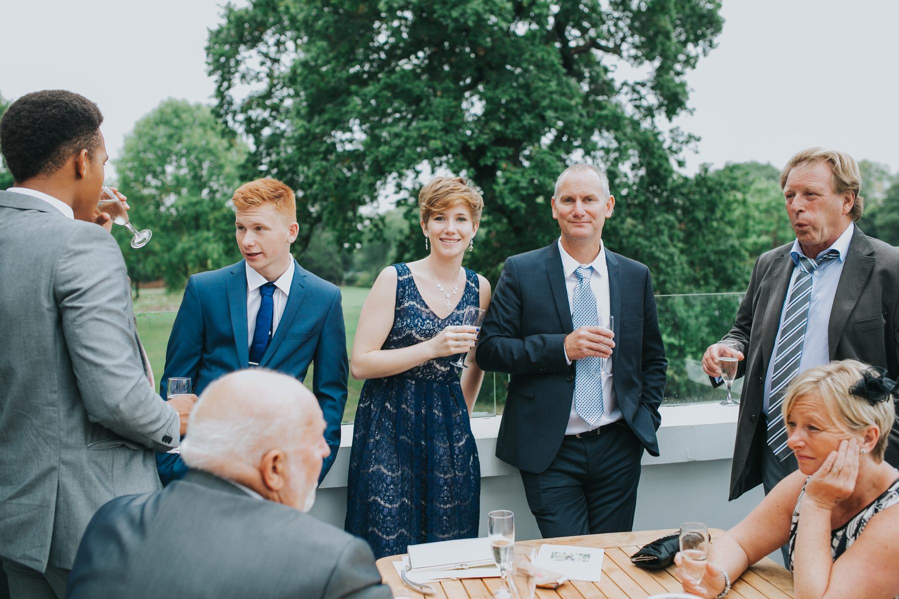 139-Belair House Dulwich wedding guests drinking patio.jpg