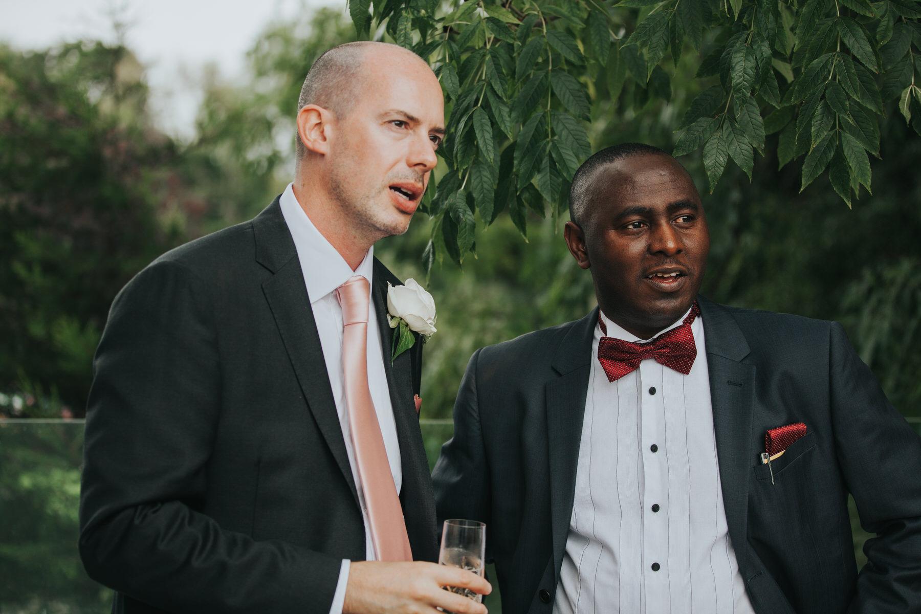 156-groom relaxing drinks wedding reception Belair House.jpg