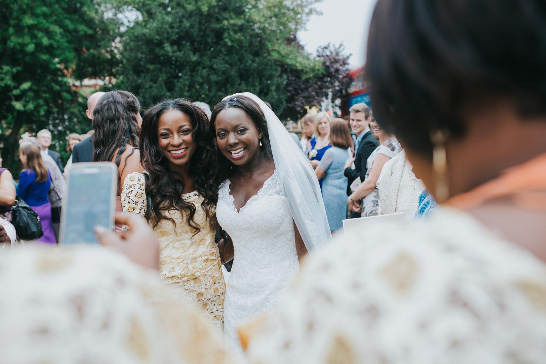 131 bride posing with bridesmaid reportage photography.jpg