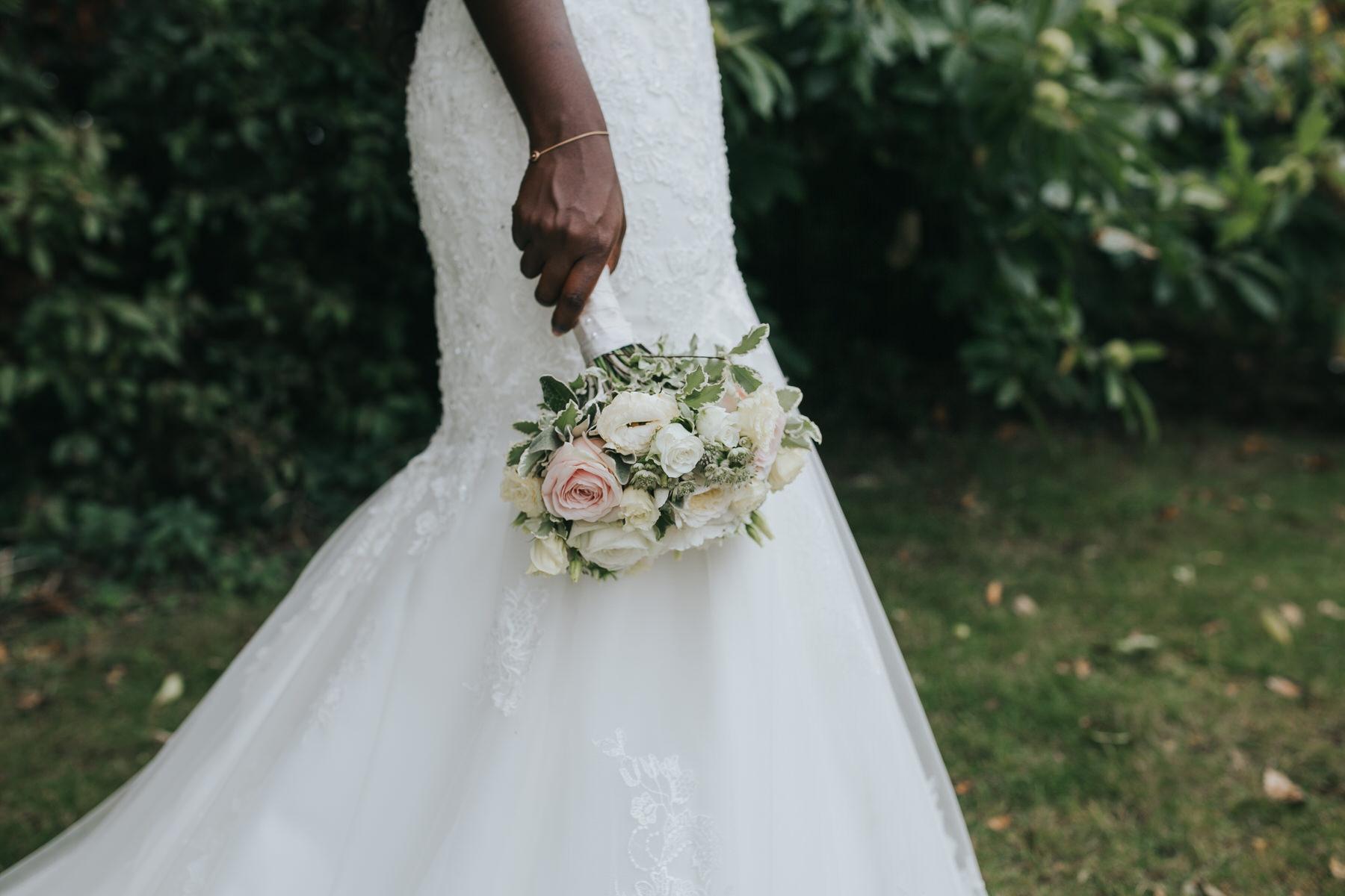 195 bride holding bouquet during wedding portraits.jpg
