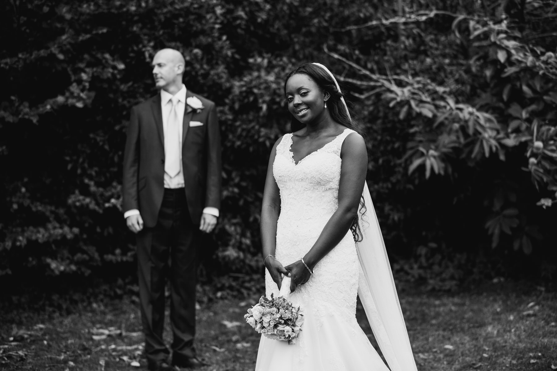 209 bnw bride holding bouquet with groom.jpg