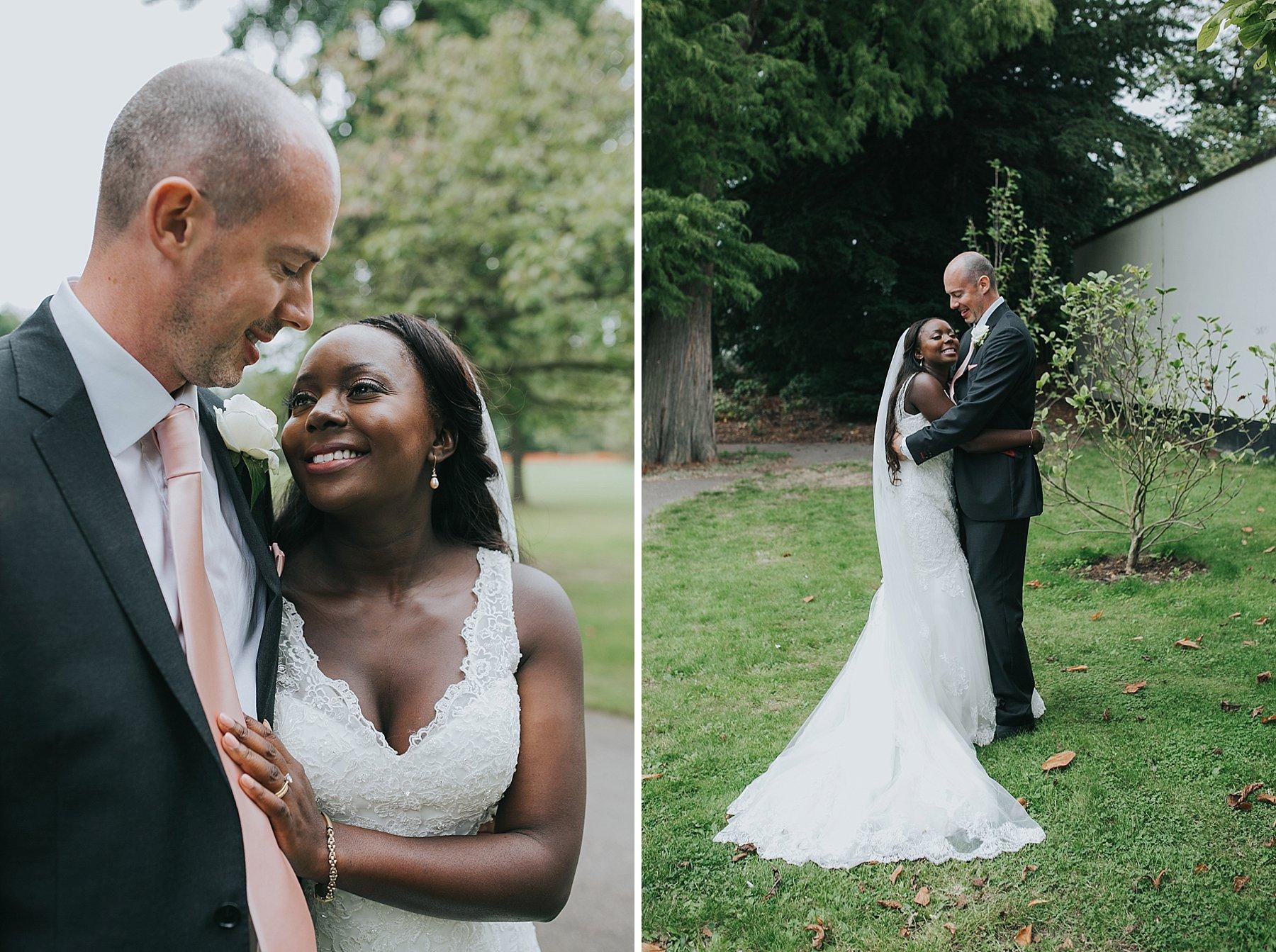 233-Belair House Dulwich wedding portraits bride embracing groom.jpg