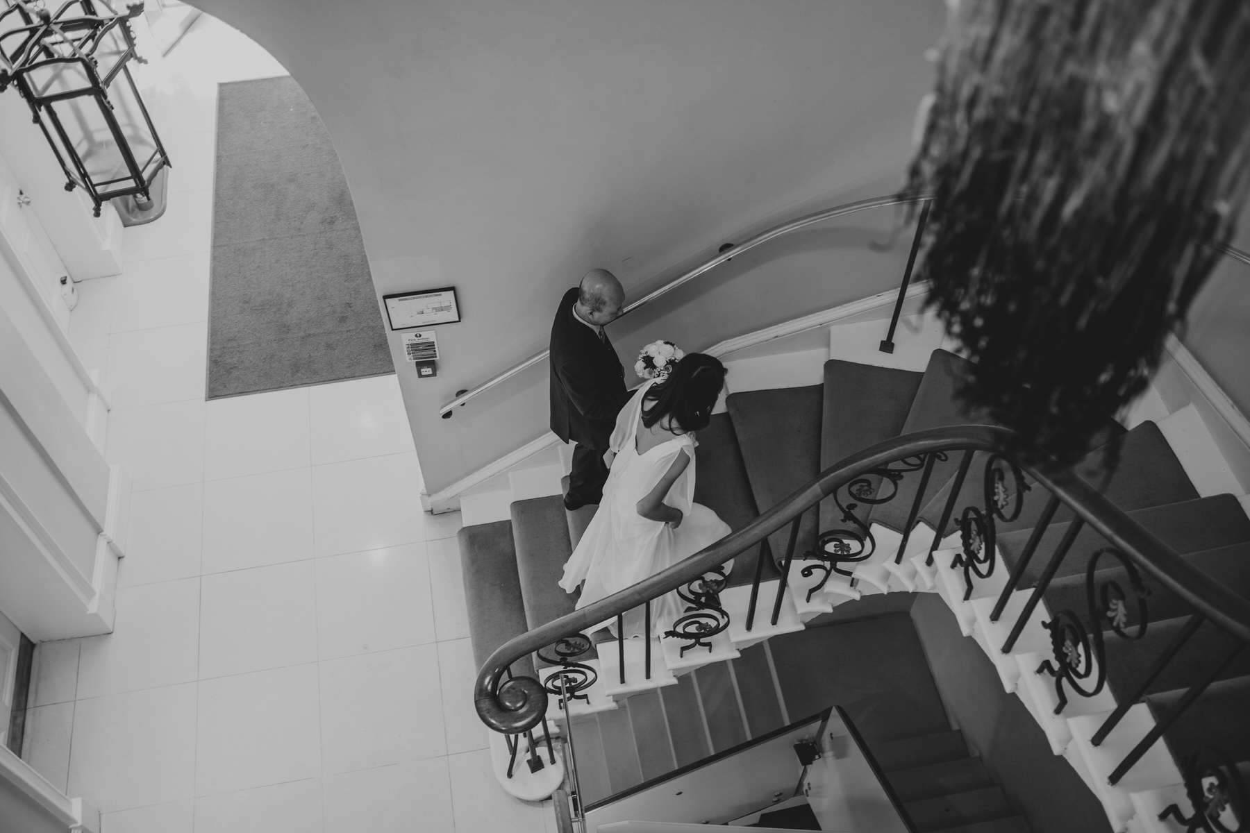 bride walking up stairs with her father Asia House