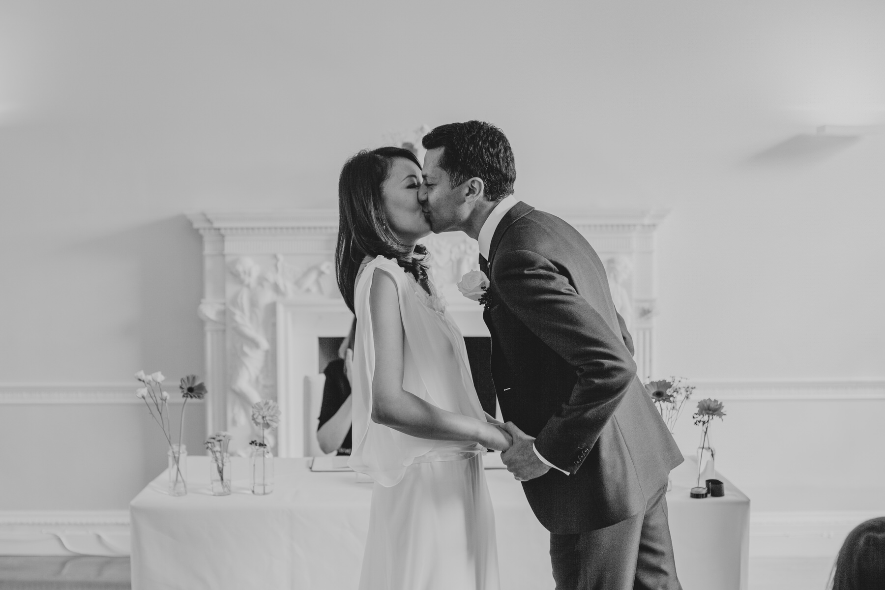 groom kisses bride as wedding ceremony concludes London documentary wedding photographer