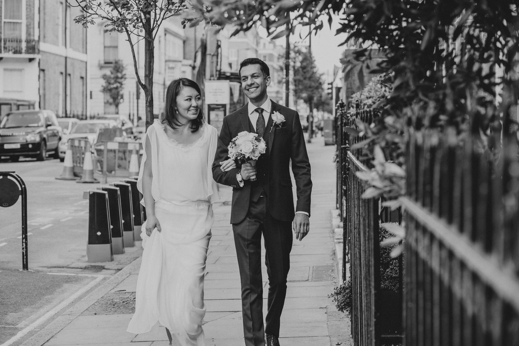 bnw groom carrying bouquet documentary wedding photographer London