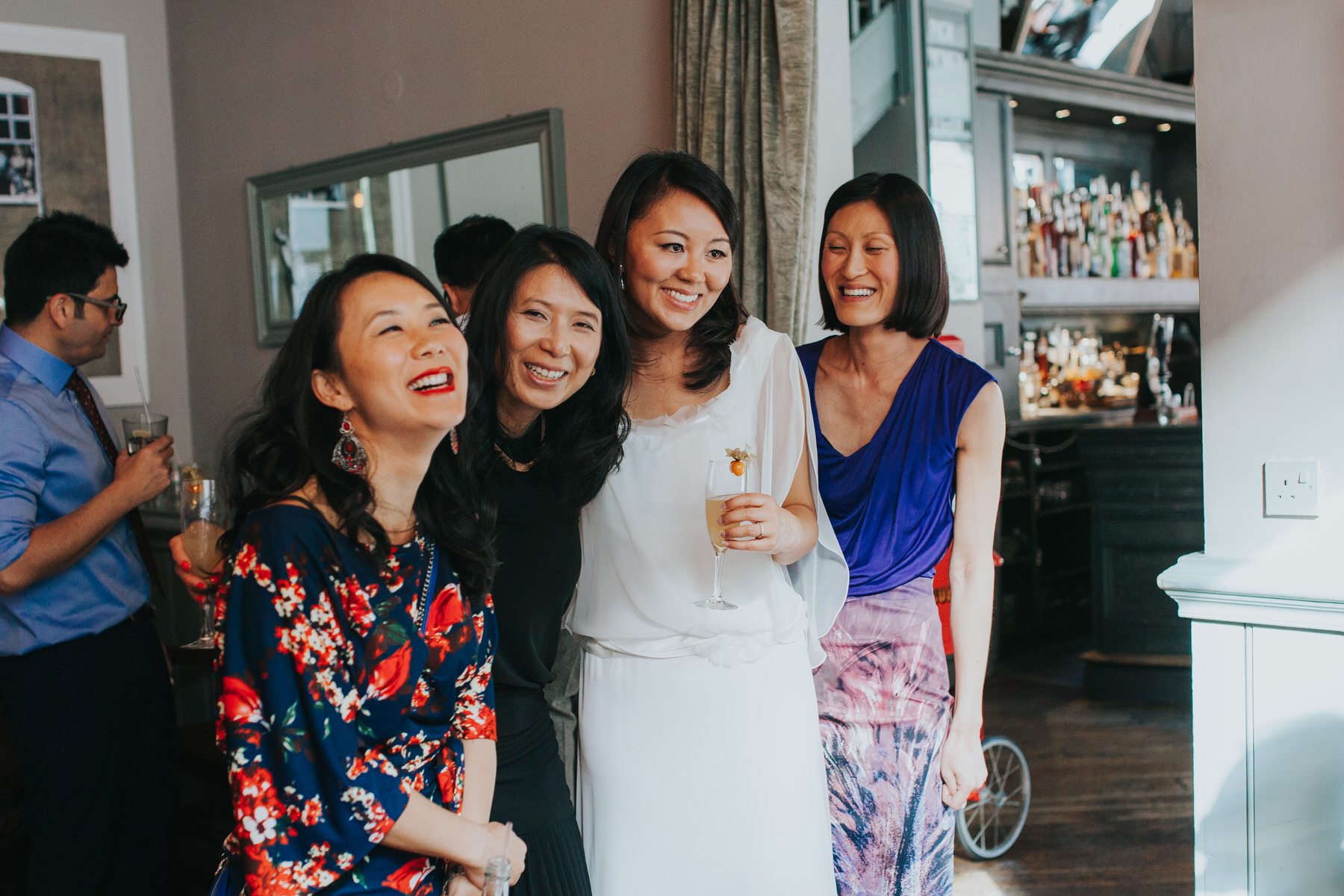 bride posing with friends drinks reception The Marylebone Asia House