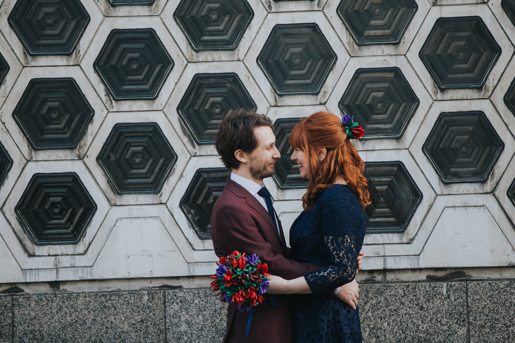 76 individualistic wedding couple embracing honeycomb wall St Barts Brewery.jpg